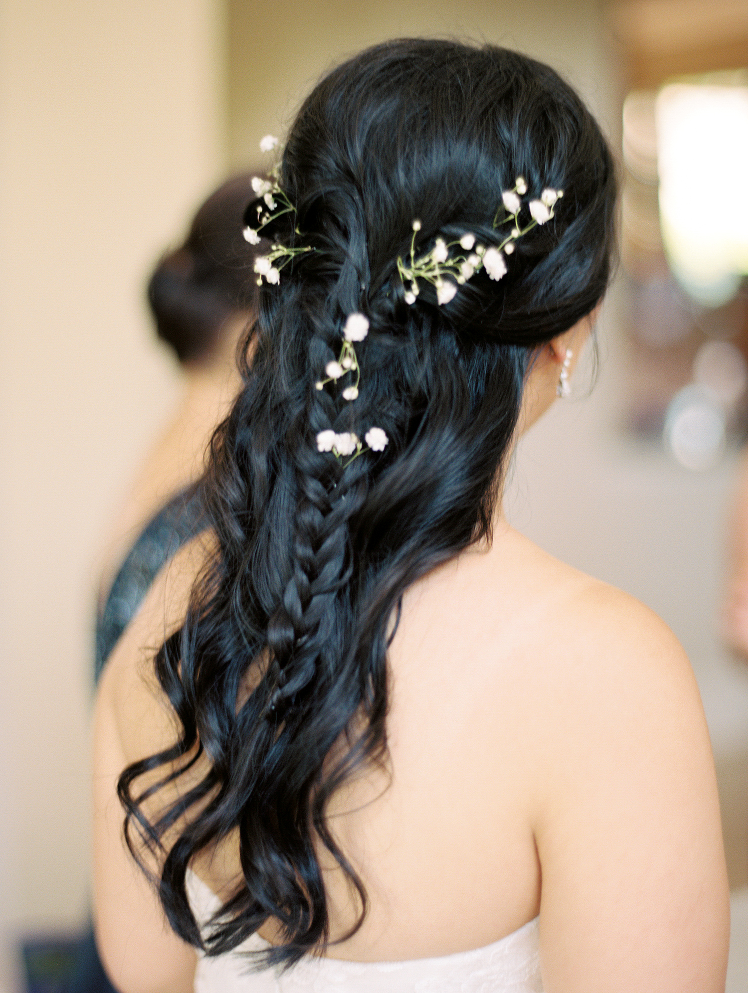 bride with half updo and braid