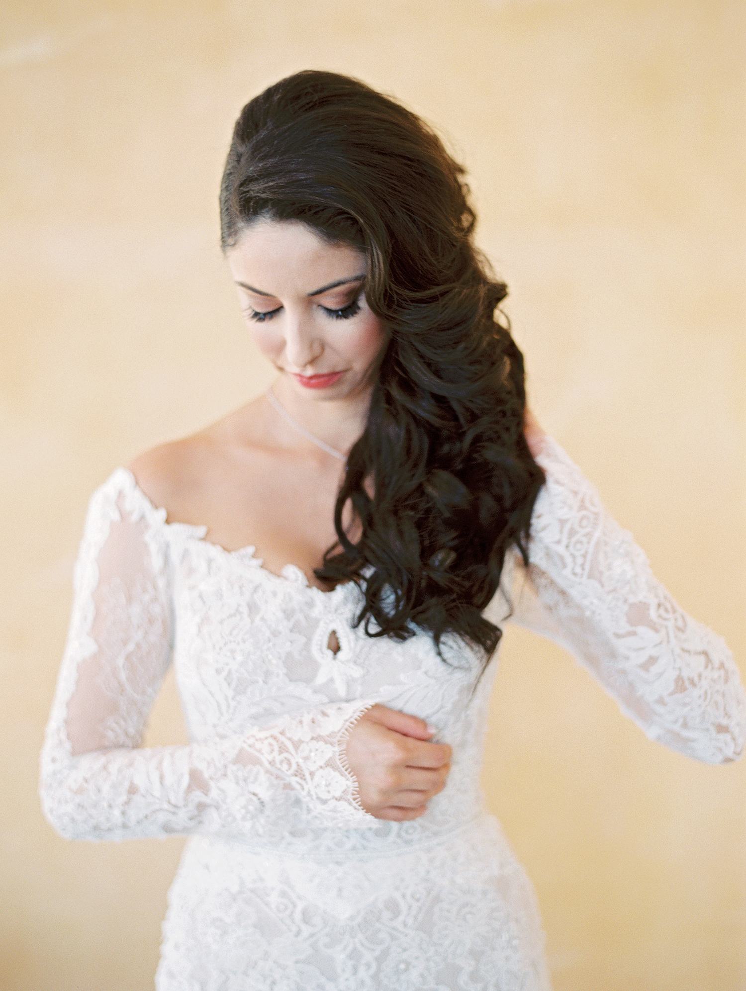 bride with off-the-shoulder dress and side-swept hair