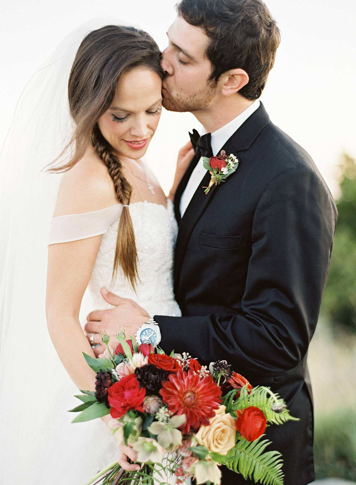 bride with long soft fishtail braid