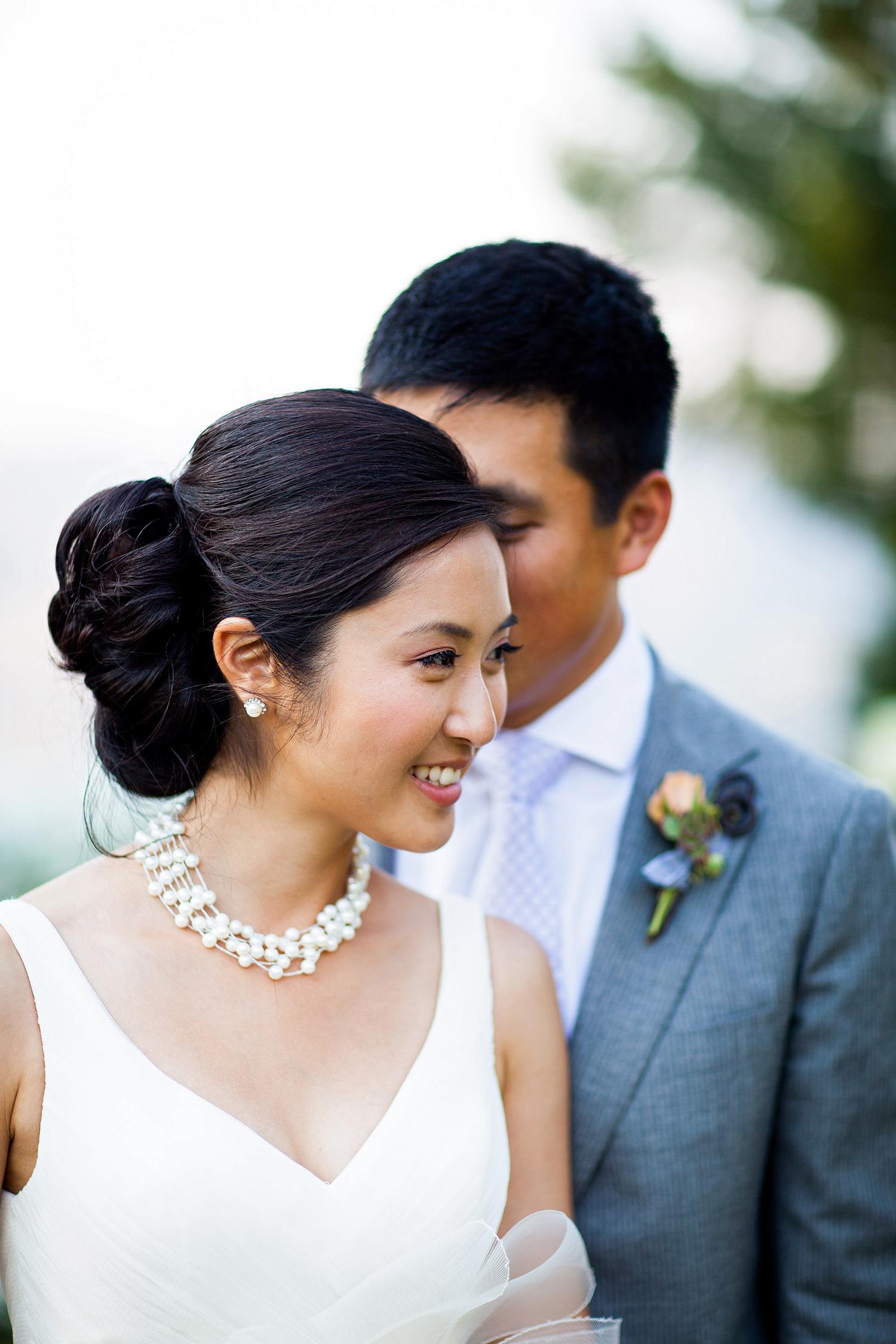 bride with v-neck dress and side bun
