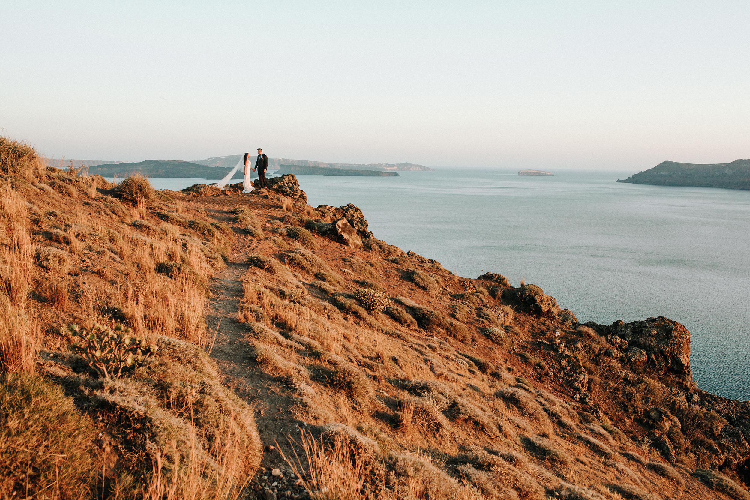 couple on hillside in santorini