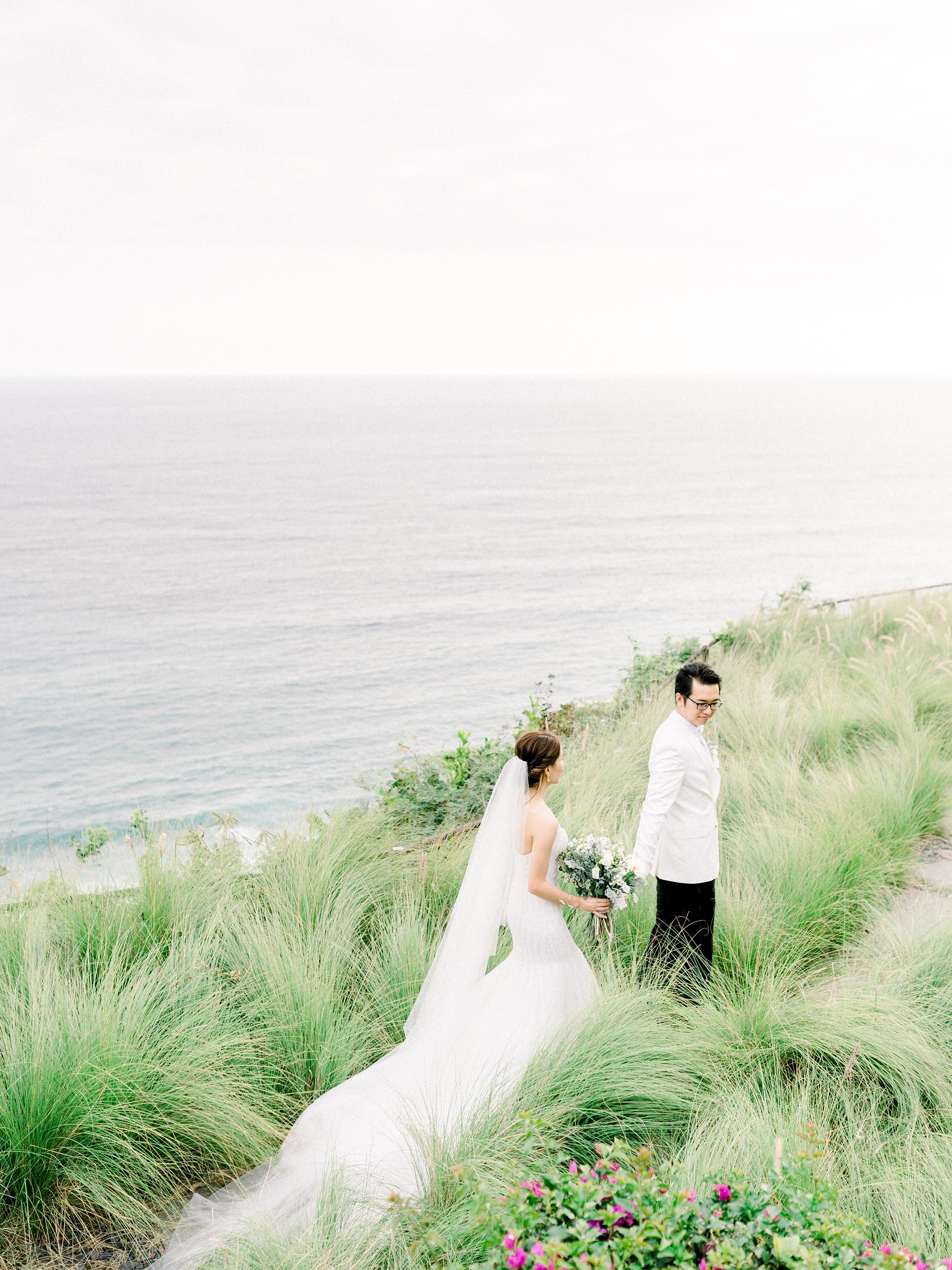 couple walking overlooking beach