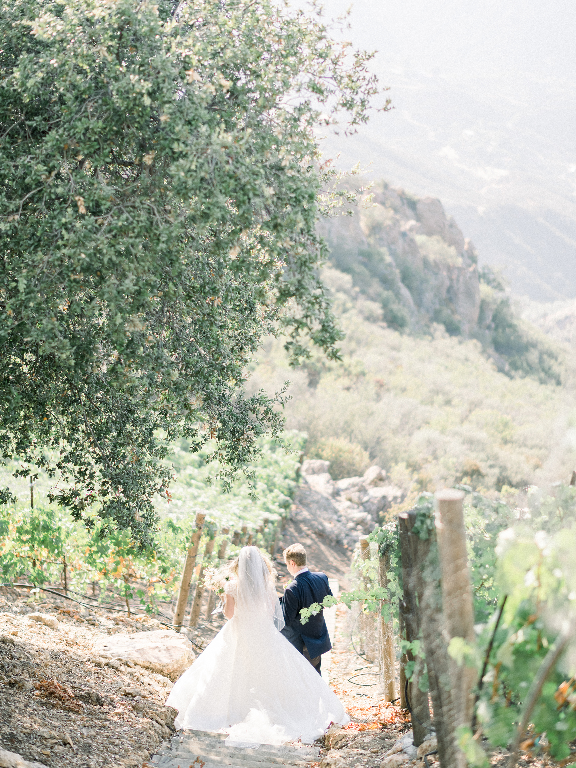 couple walking down path