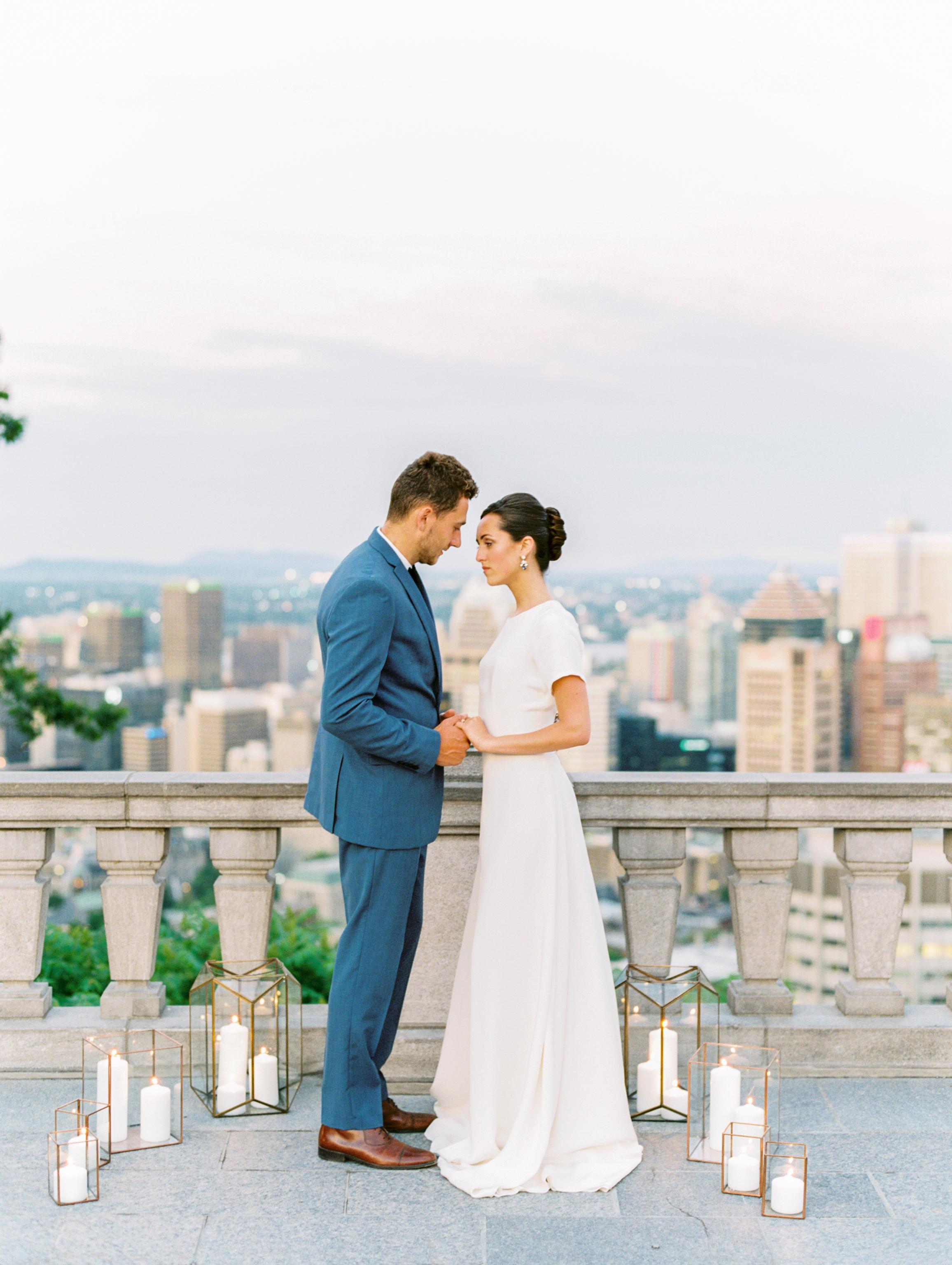 couple on balcony overlooking city
