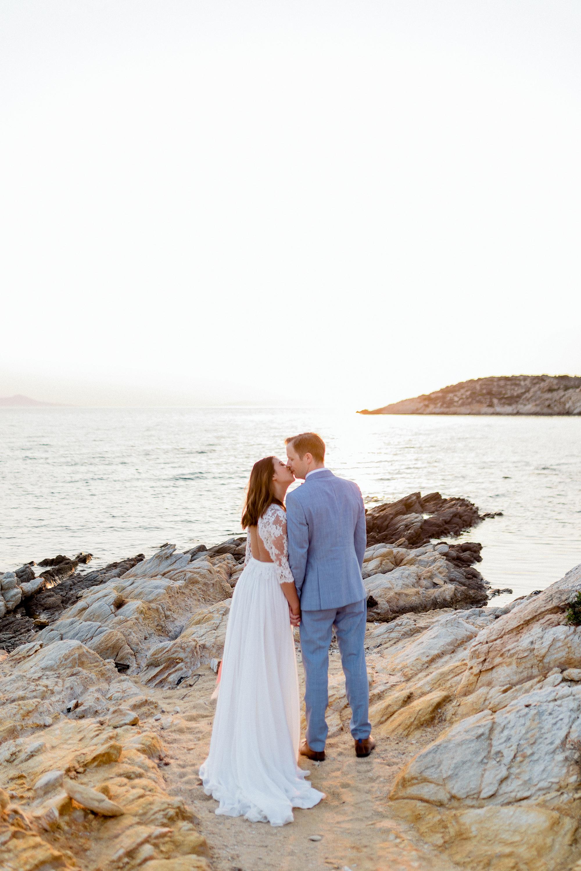 couple standing overlooking water