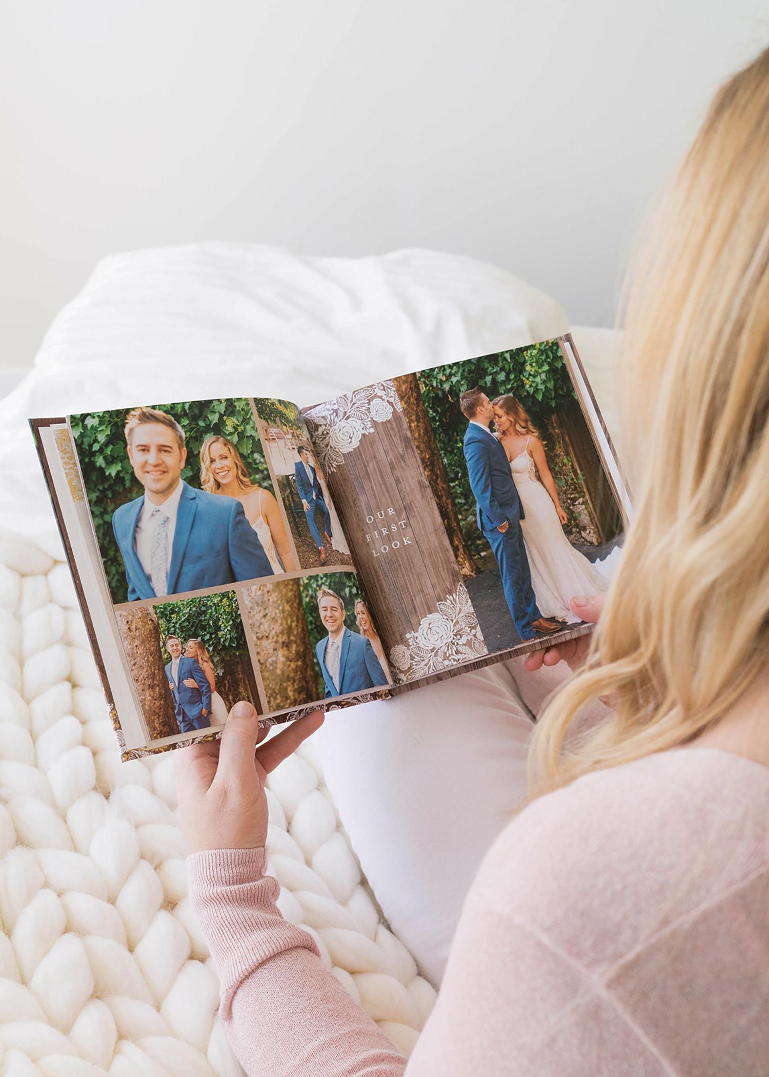 wedding photo album book women looking at book