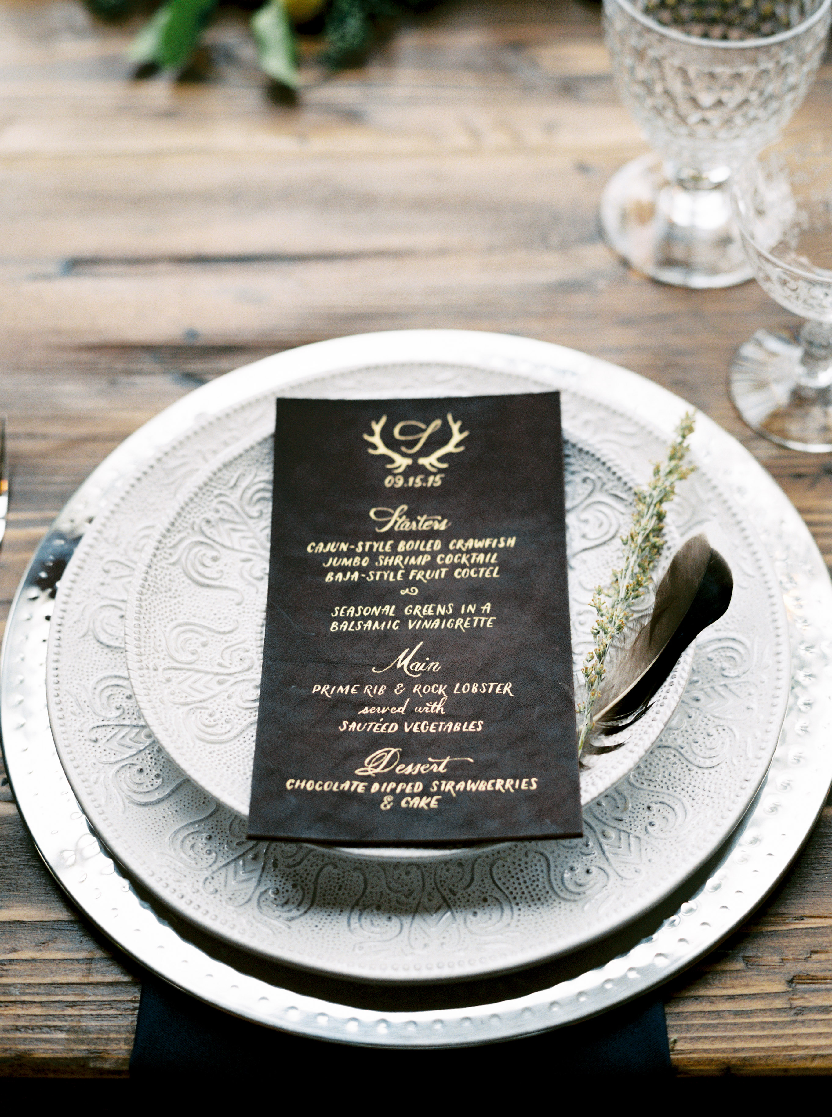 leather wedding menu with gold calligraphy