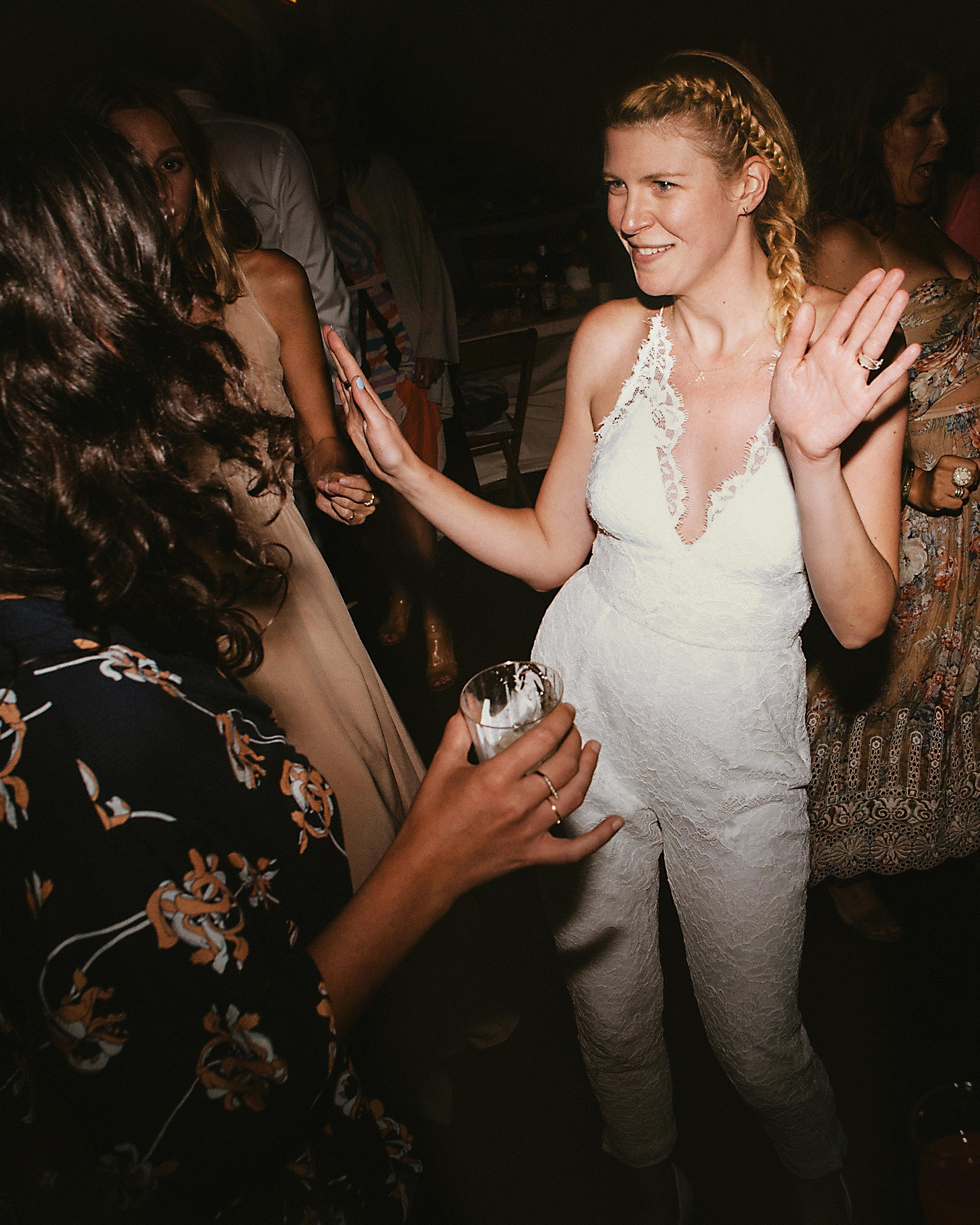 Bride Dancing in a Lacey Jumpsuit