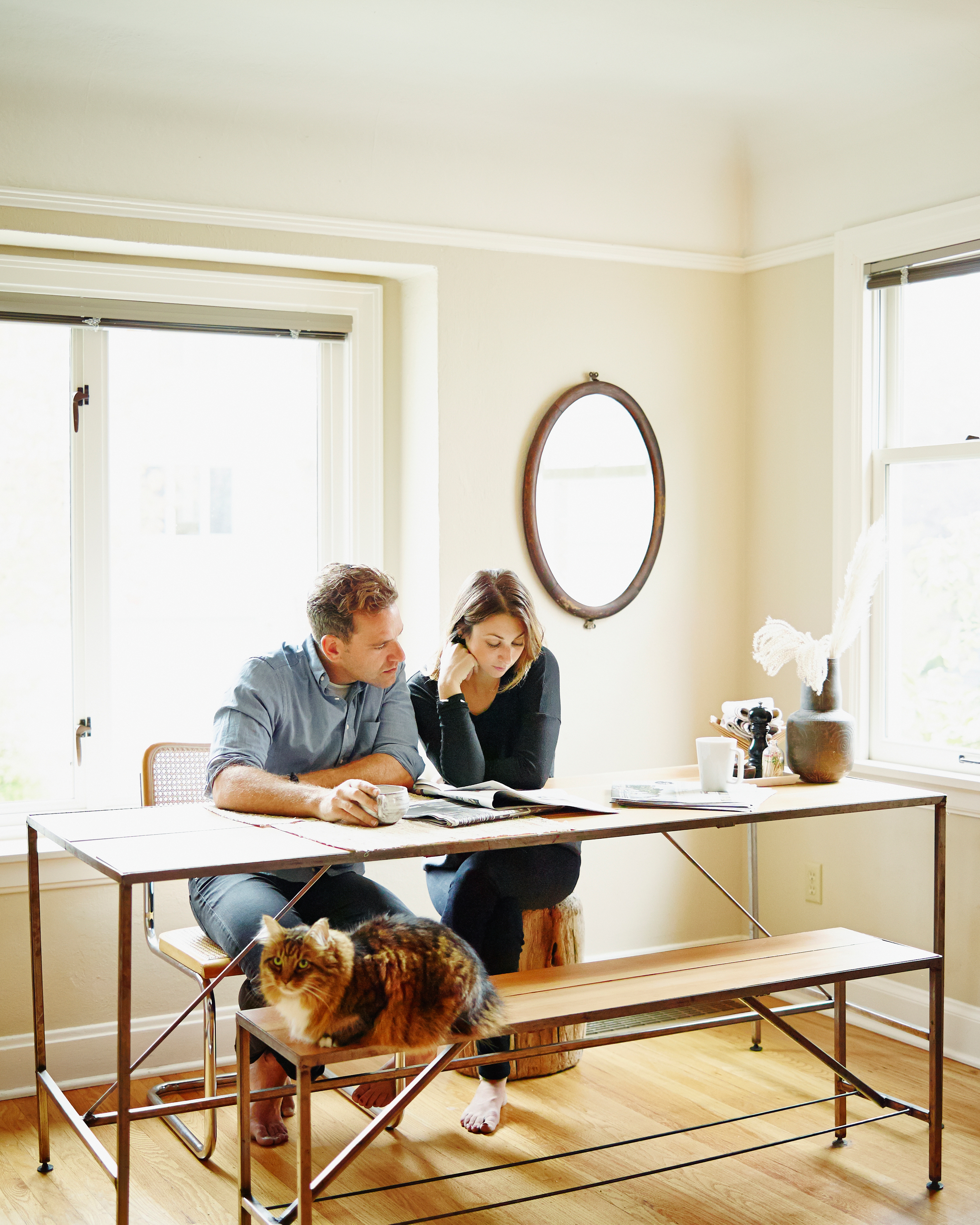 living-together-couple-at-table-reading-paper-cat-0116.jpg