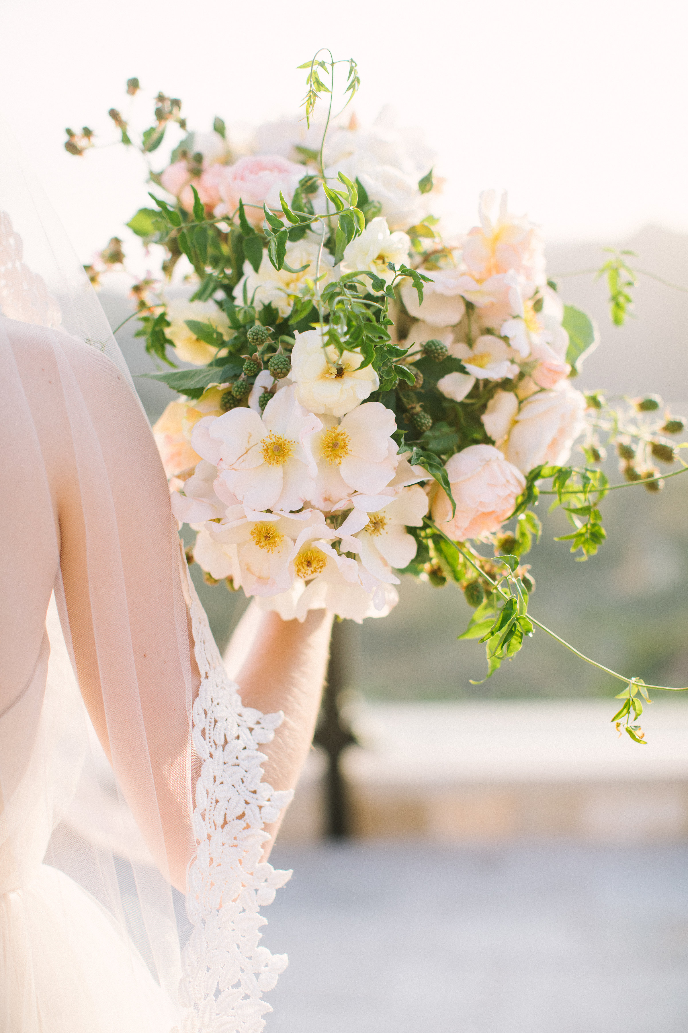spring wedding bouquet with japanese anemones