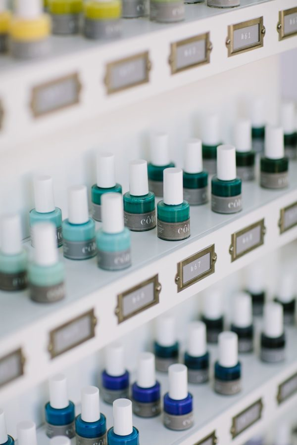 display of blue and green nail polish