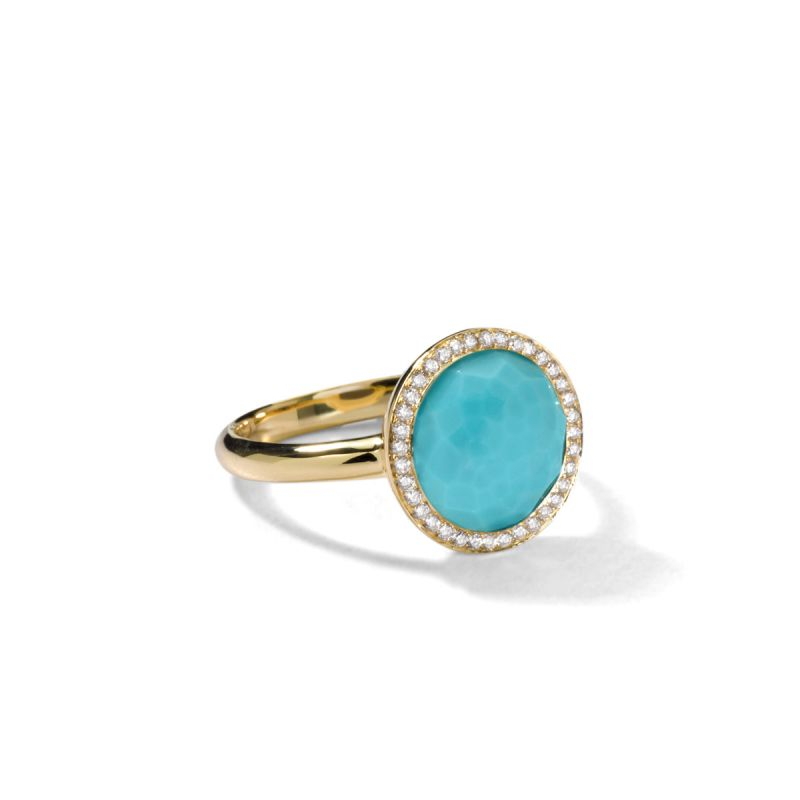teal stone surrounded by diamonds with gold band