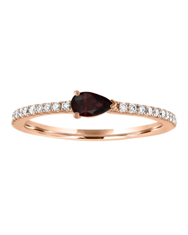 tear drop shaped jewel on rose gold diamond engraved band