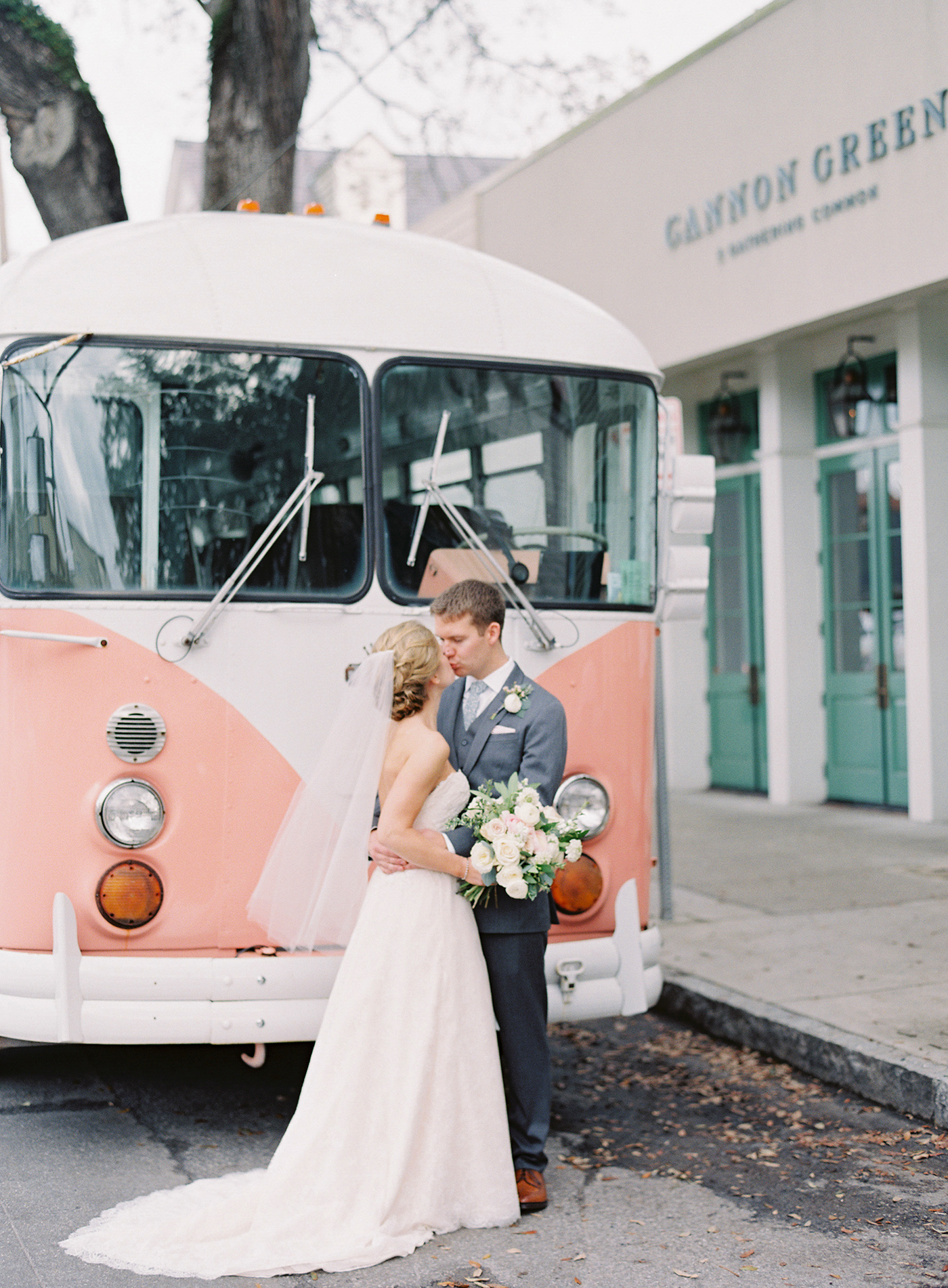 unique wedding color palettes couple kissing in front of pink vintage volkswagen bus