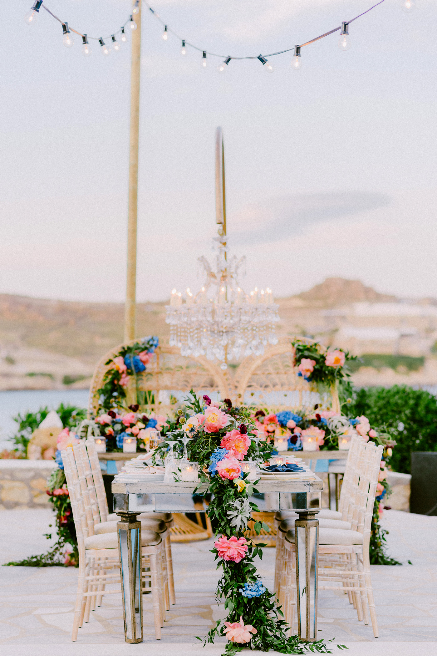unique wedding color blue and pink floral garlands on table setting in southwest america