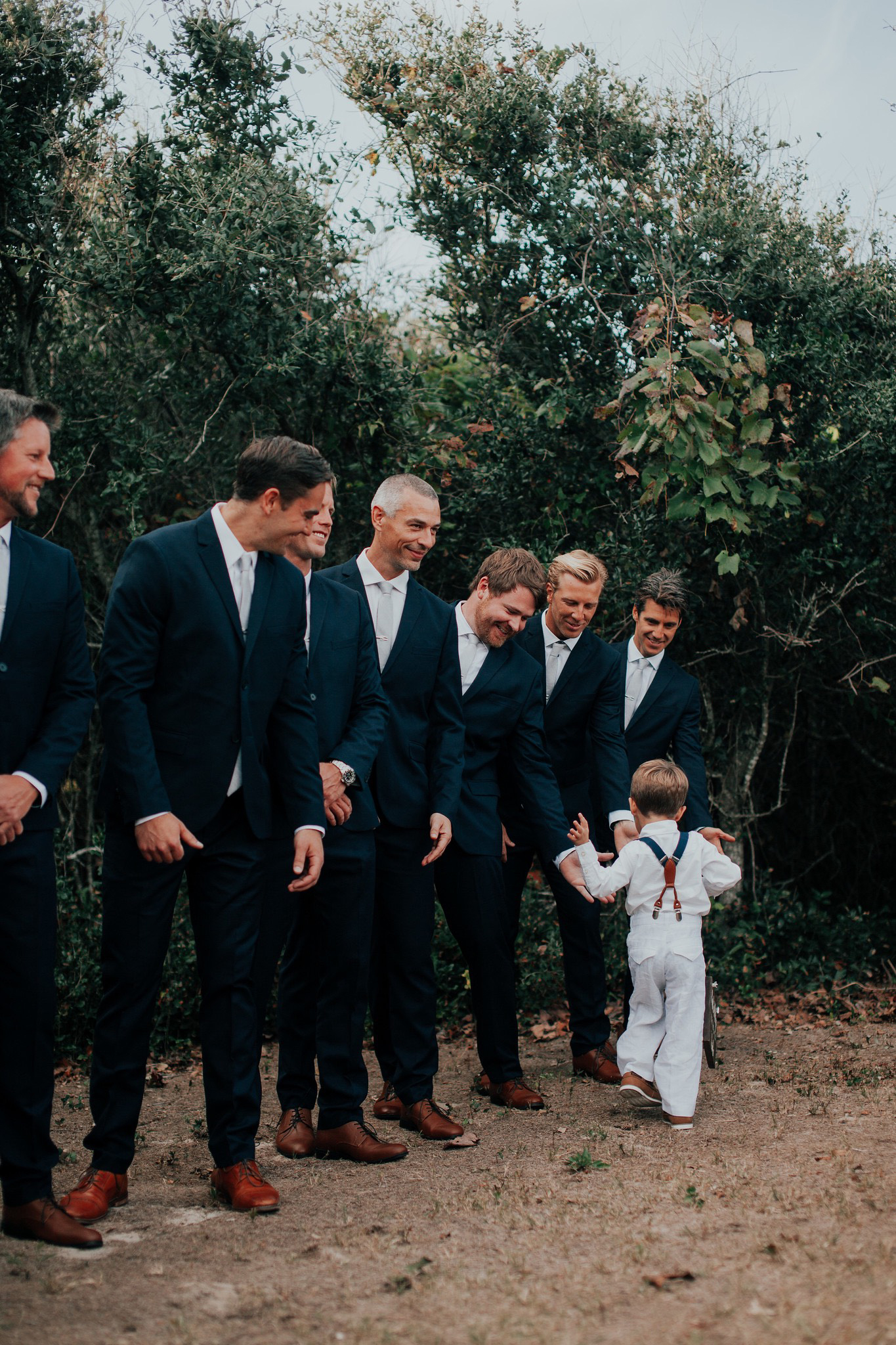 boy with groomsmen