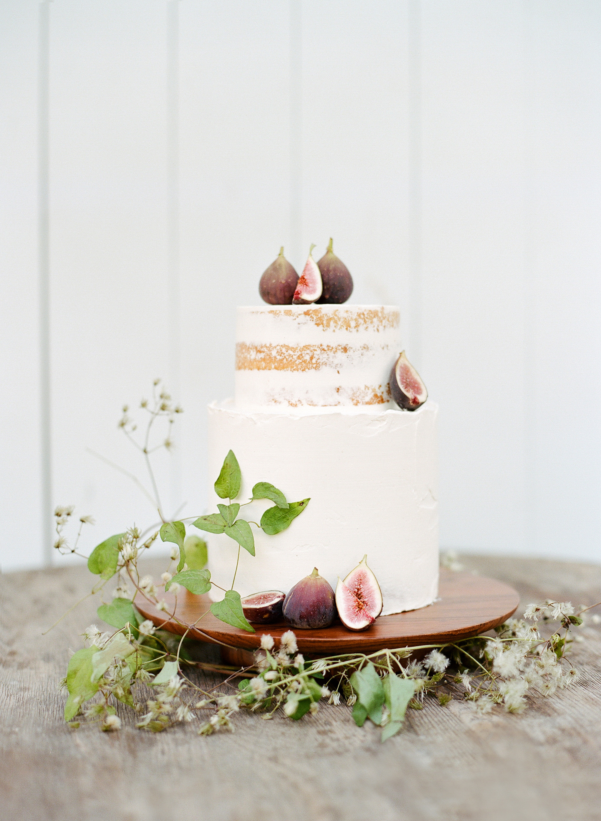 2-tier fruit filled cake decorated with figs