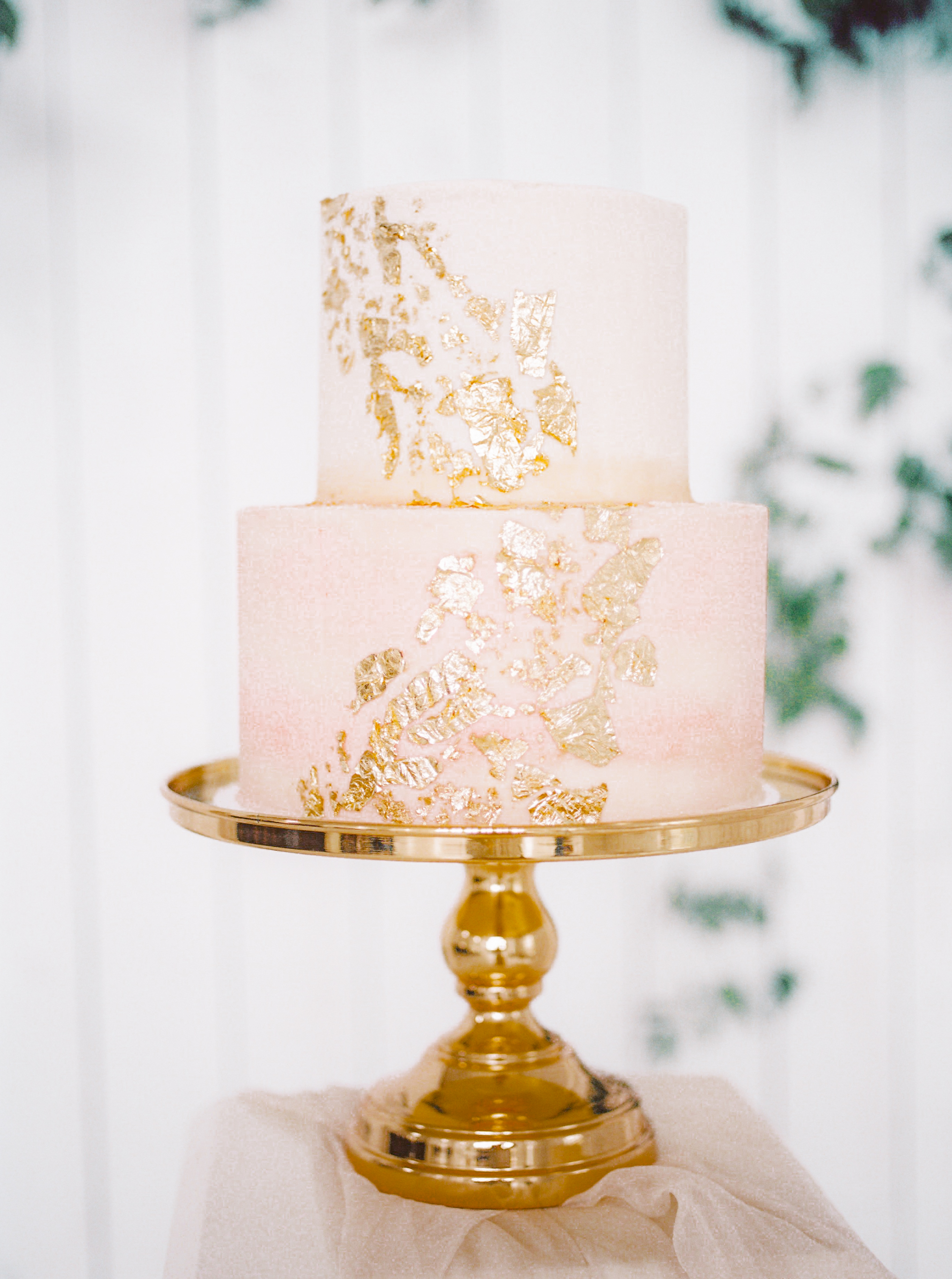 2-tier cake with gold leaf decoration