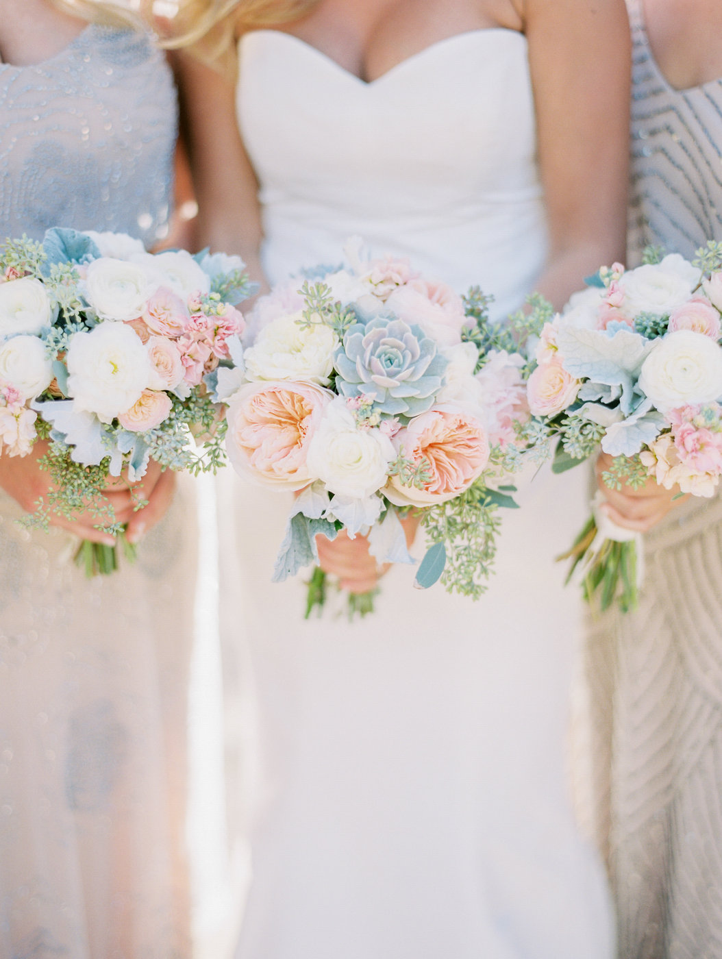 pastel bouquet with mint succulents and pink and white roses