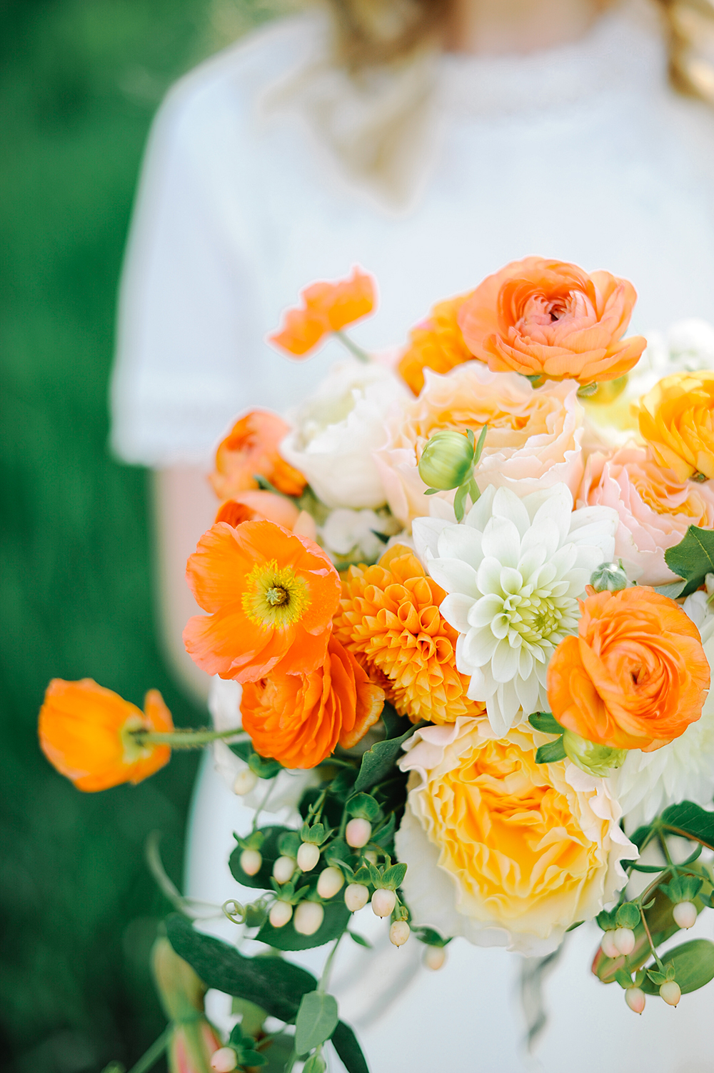 monochromatic bouquet bright orange flowers