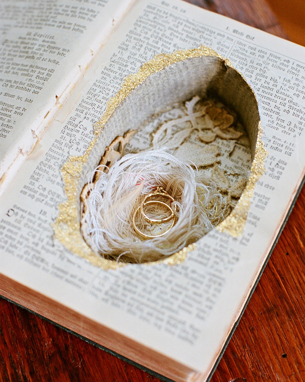 wedding rings in secret hollowed out compartment book