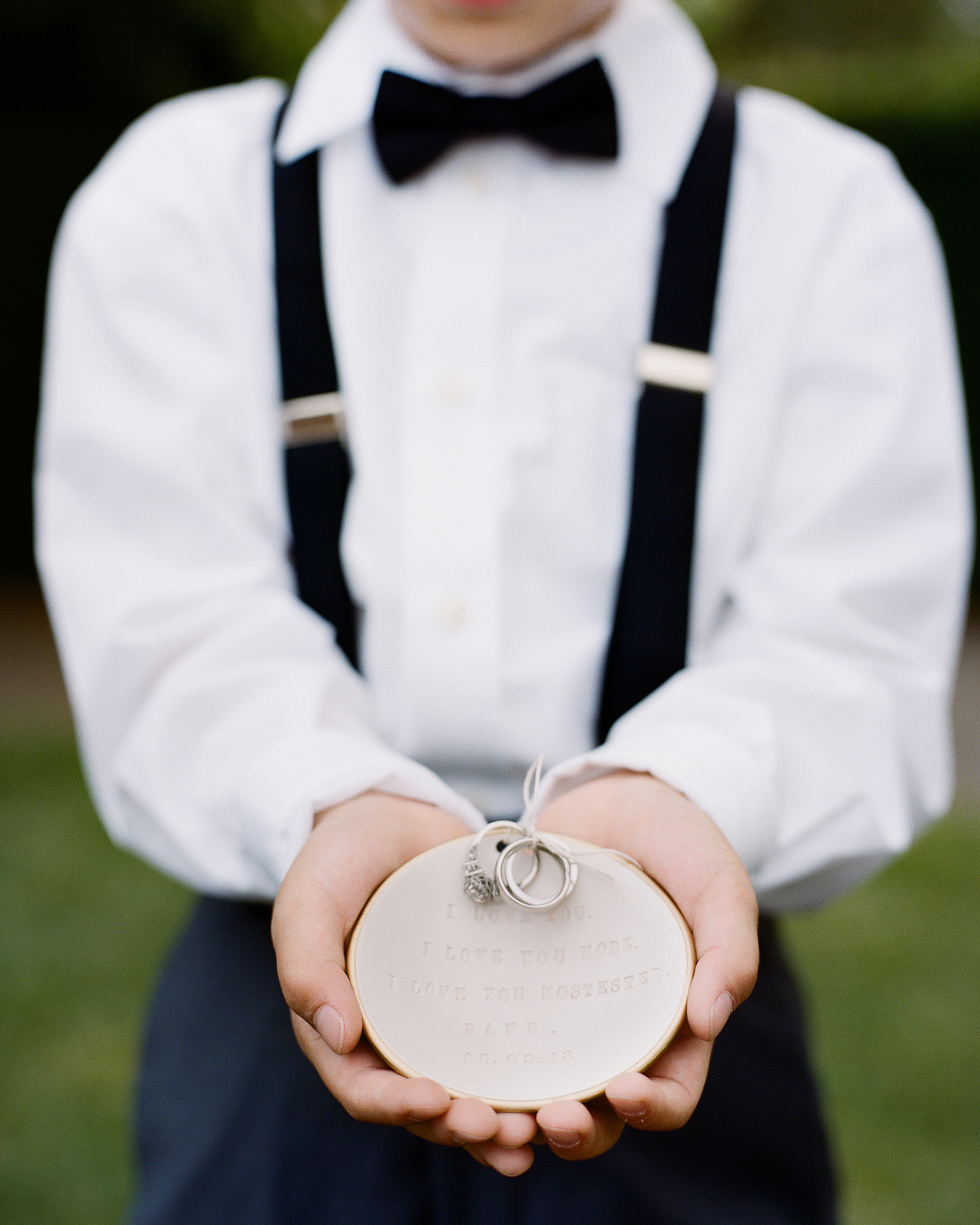 ring bearer holding decorative dish at wedding