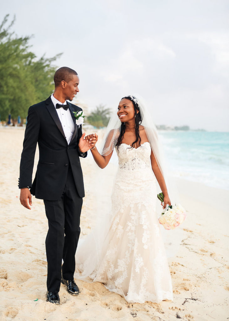 beach wedding dresses couple walking on beach