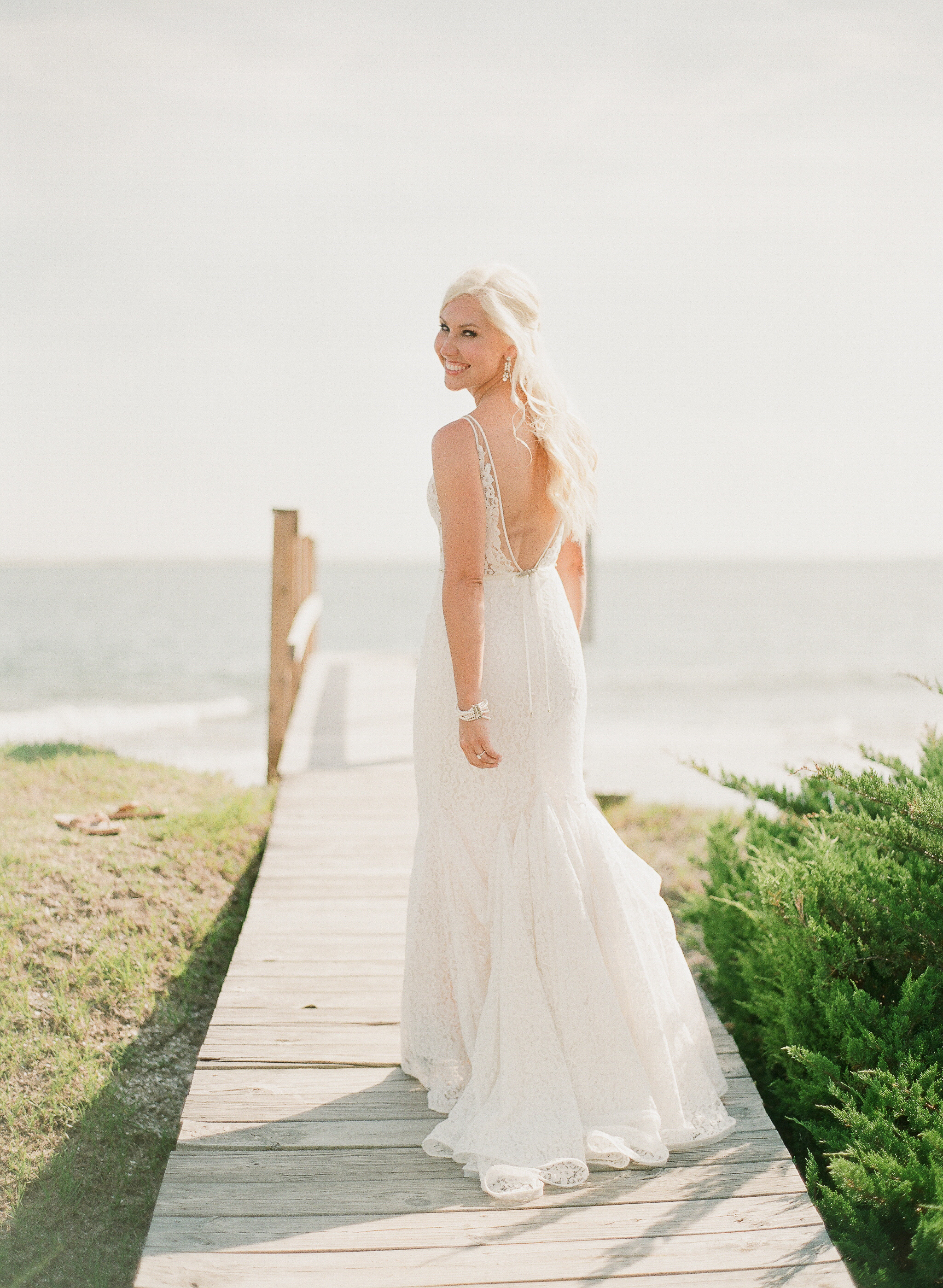beach wedding dresses bride on boardwalk by the beach