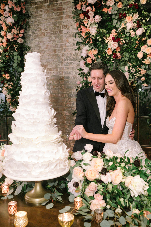 large wedding cake with ruffles