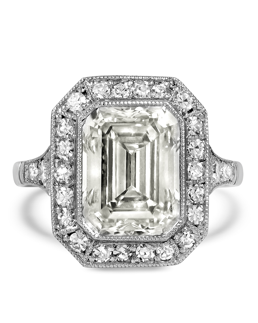emerald cut diamond ring surrounded by single cut diamond accents