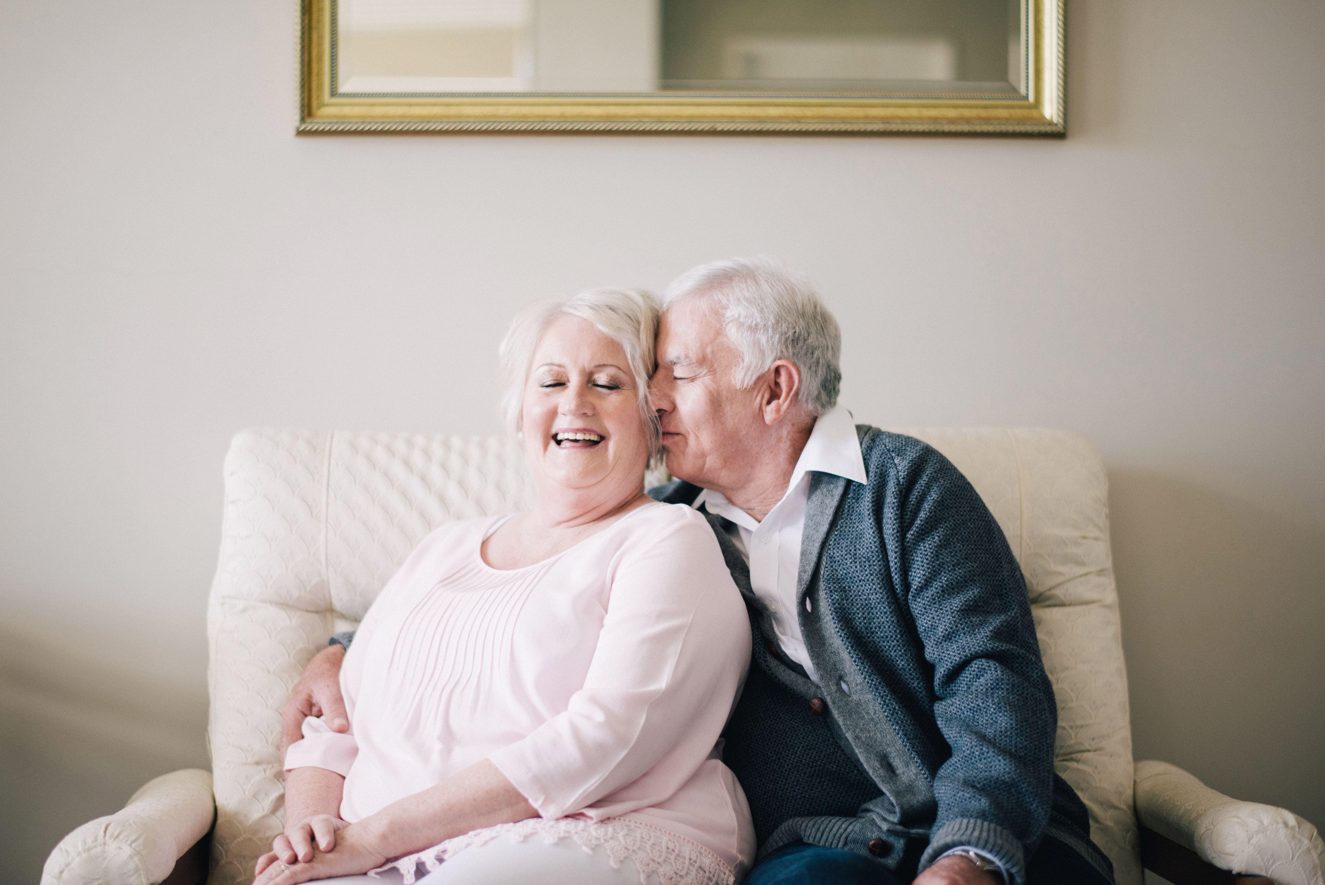 anniversary photo shoot andy margaret kiss on cheek