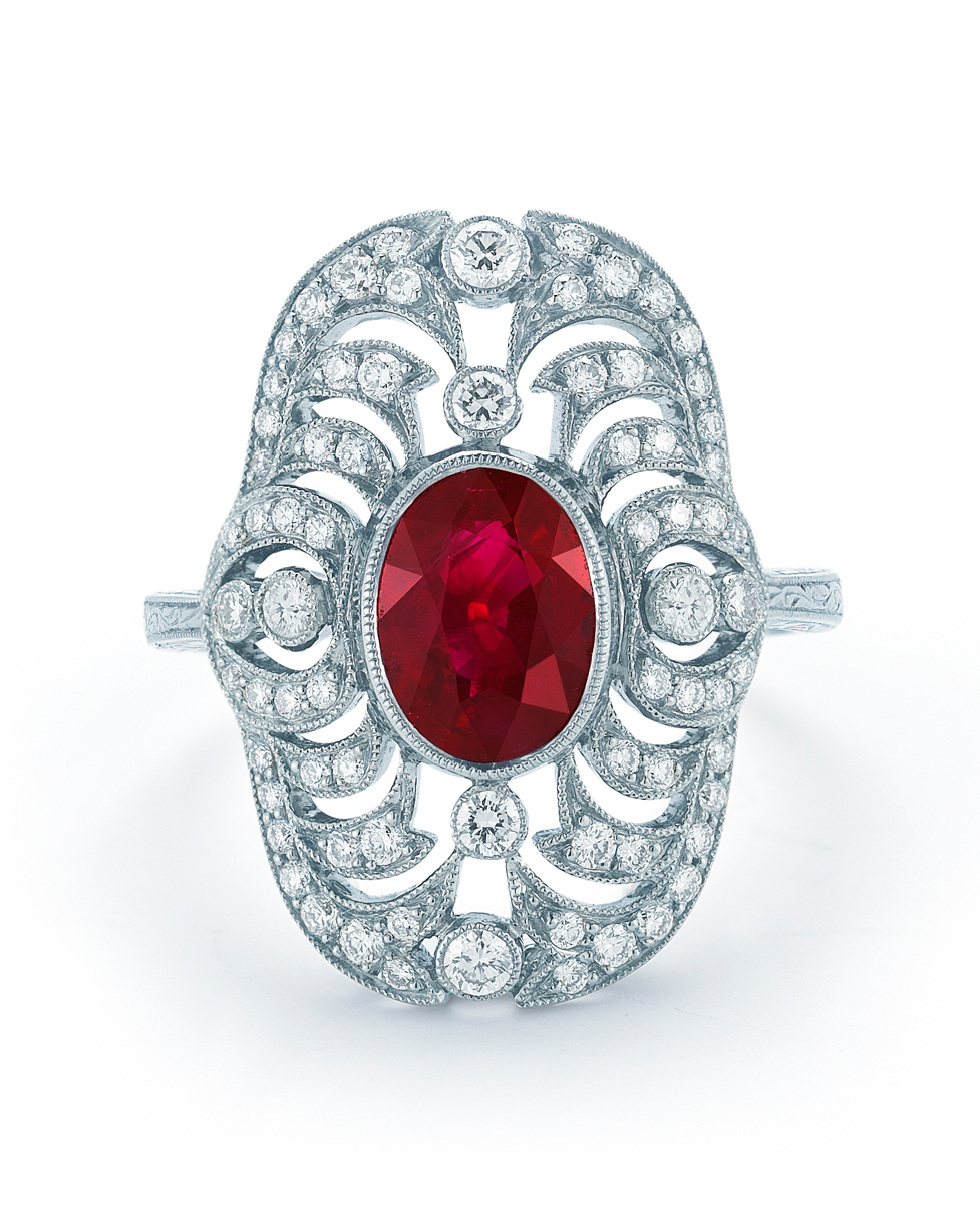 Vintage Ruby Engagement Ring with Intricate Diamond Border