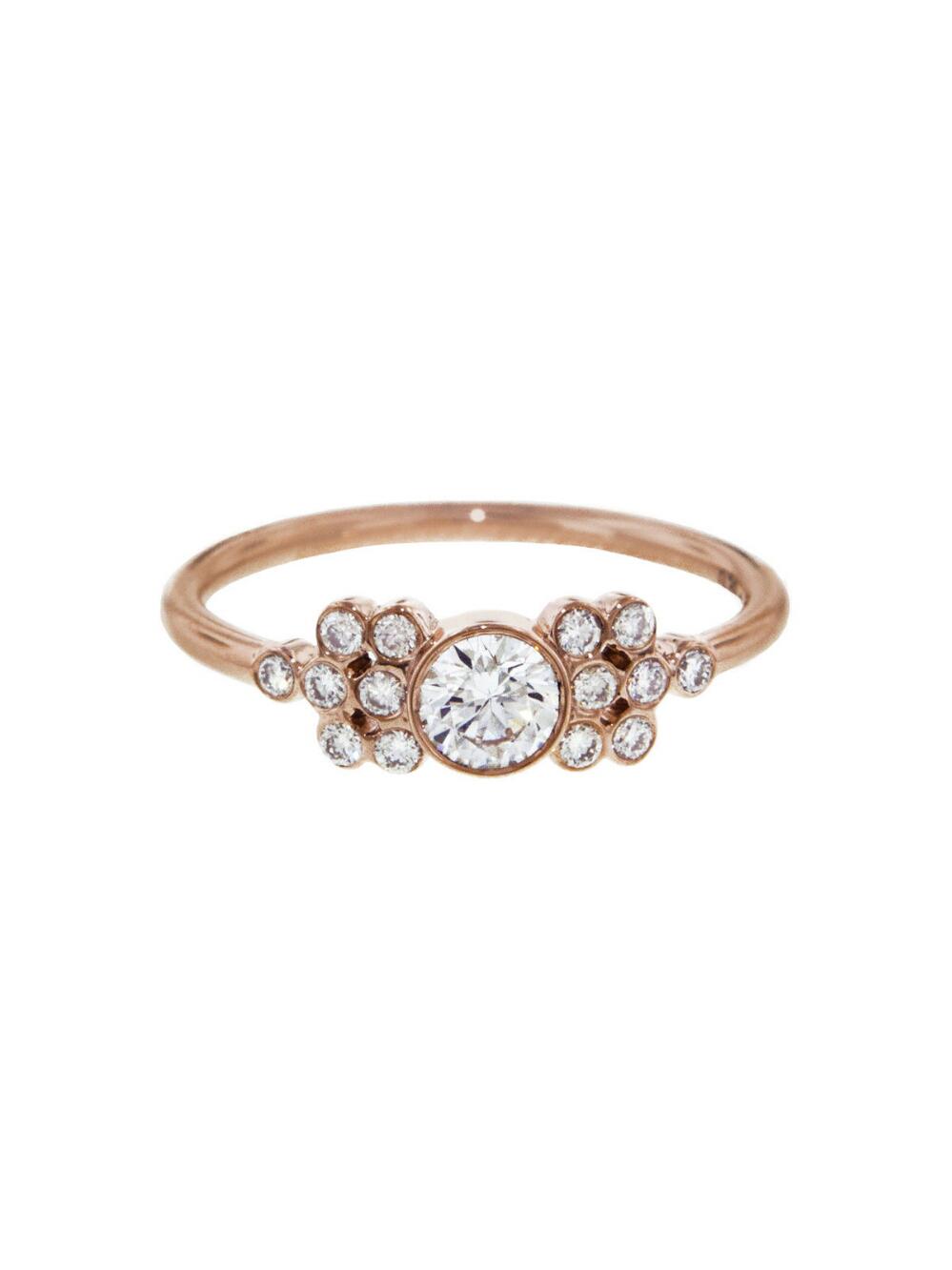 bezel set white diamond framed cluster engagement ring