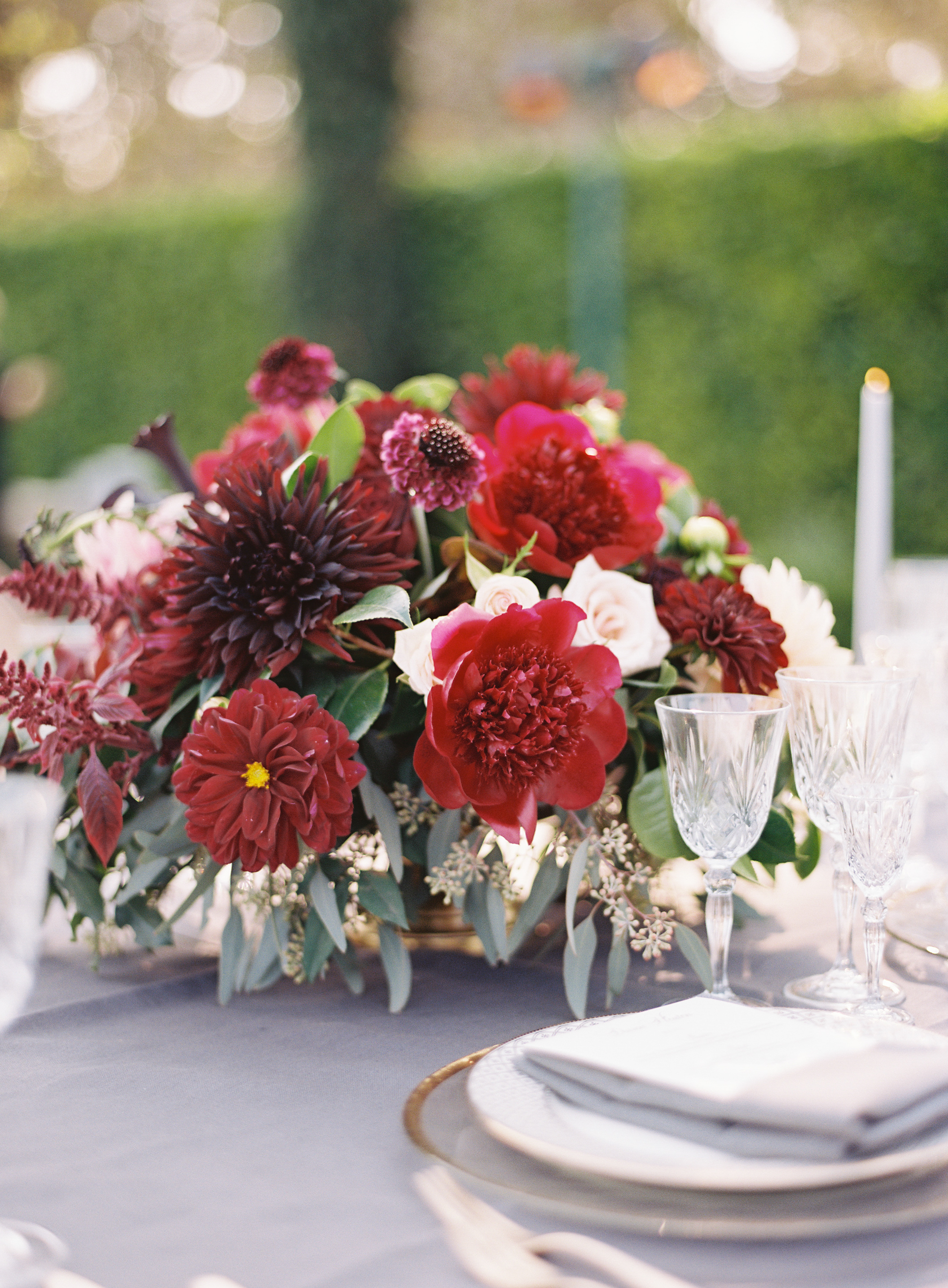 jewel-toned centerpiece with red garden roses