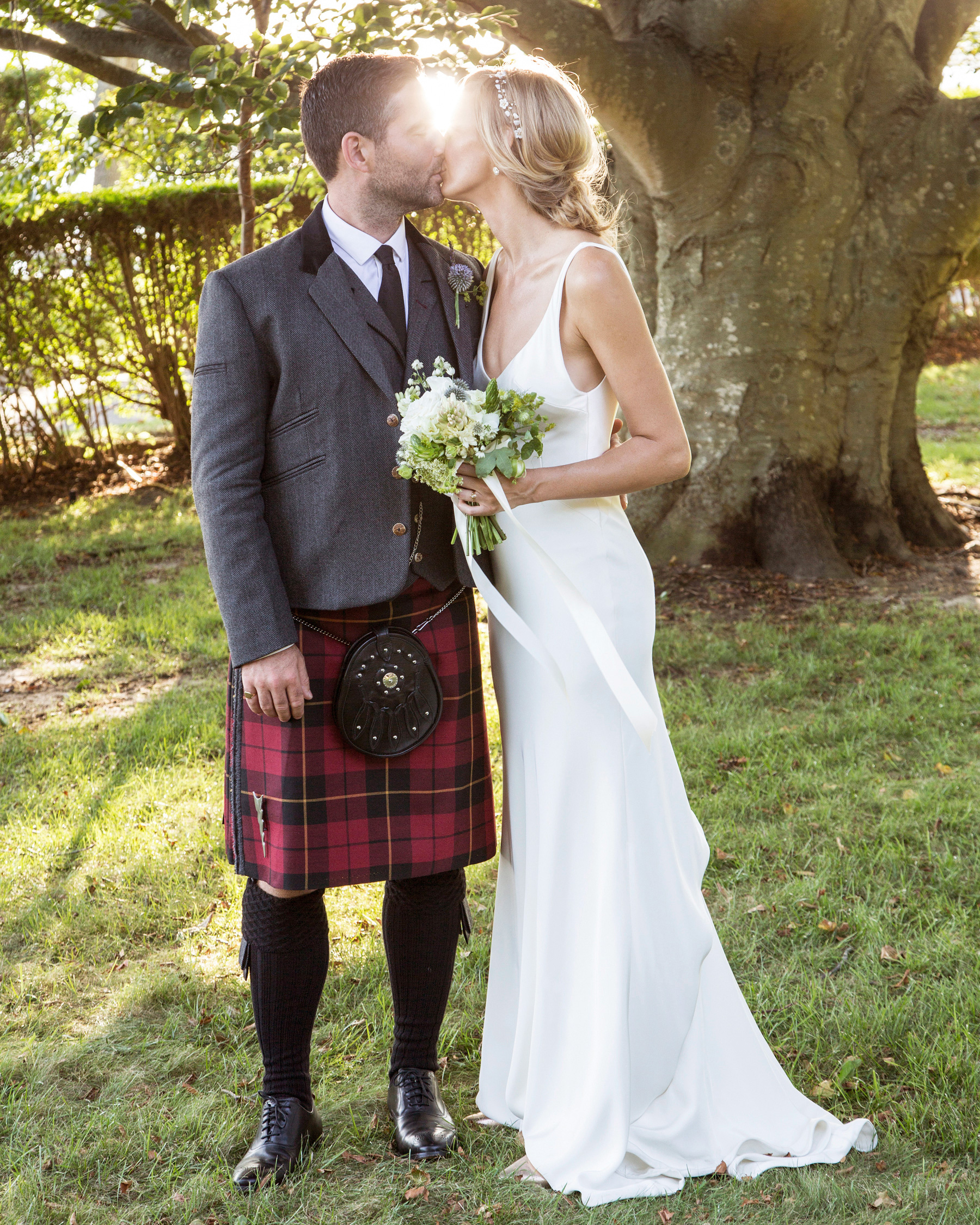 wedding couple kissing outdoors groom with kilt