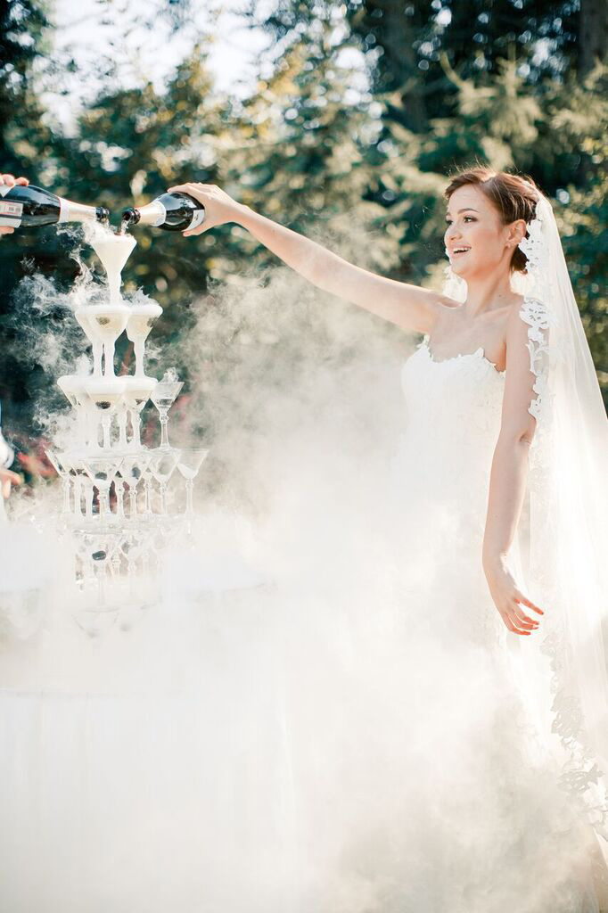 wedding champagne towers bride surrounded by mist