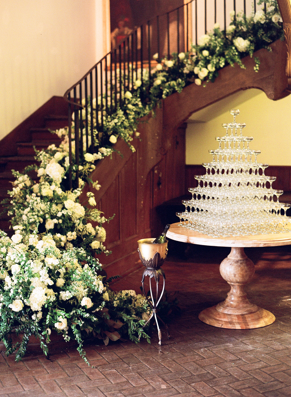 wedding champagne towers staircase with cascading flowers