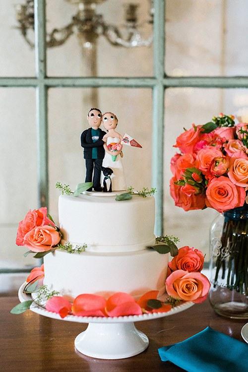 wedding cake with vibrant flowers