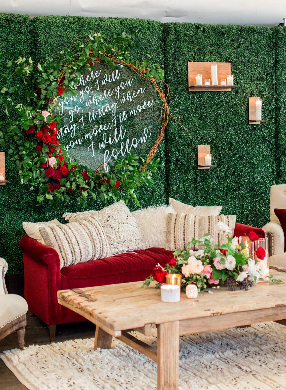 wedding lounge red couch and greenery wall