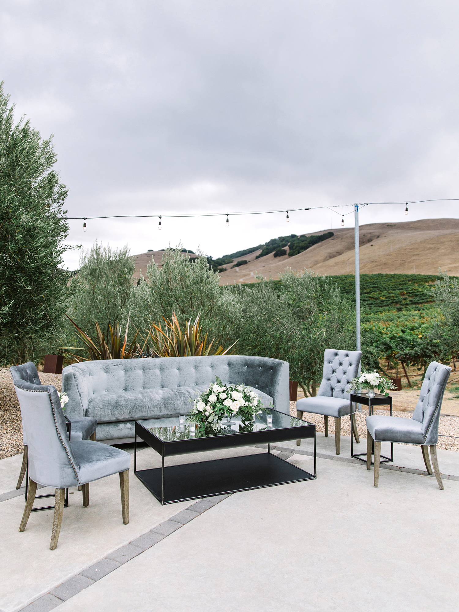 wedding lounge gray velvet couches outdoors