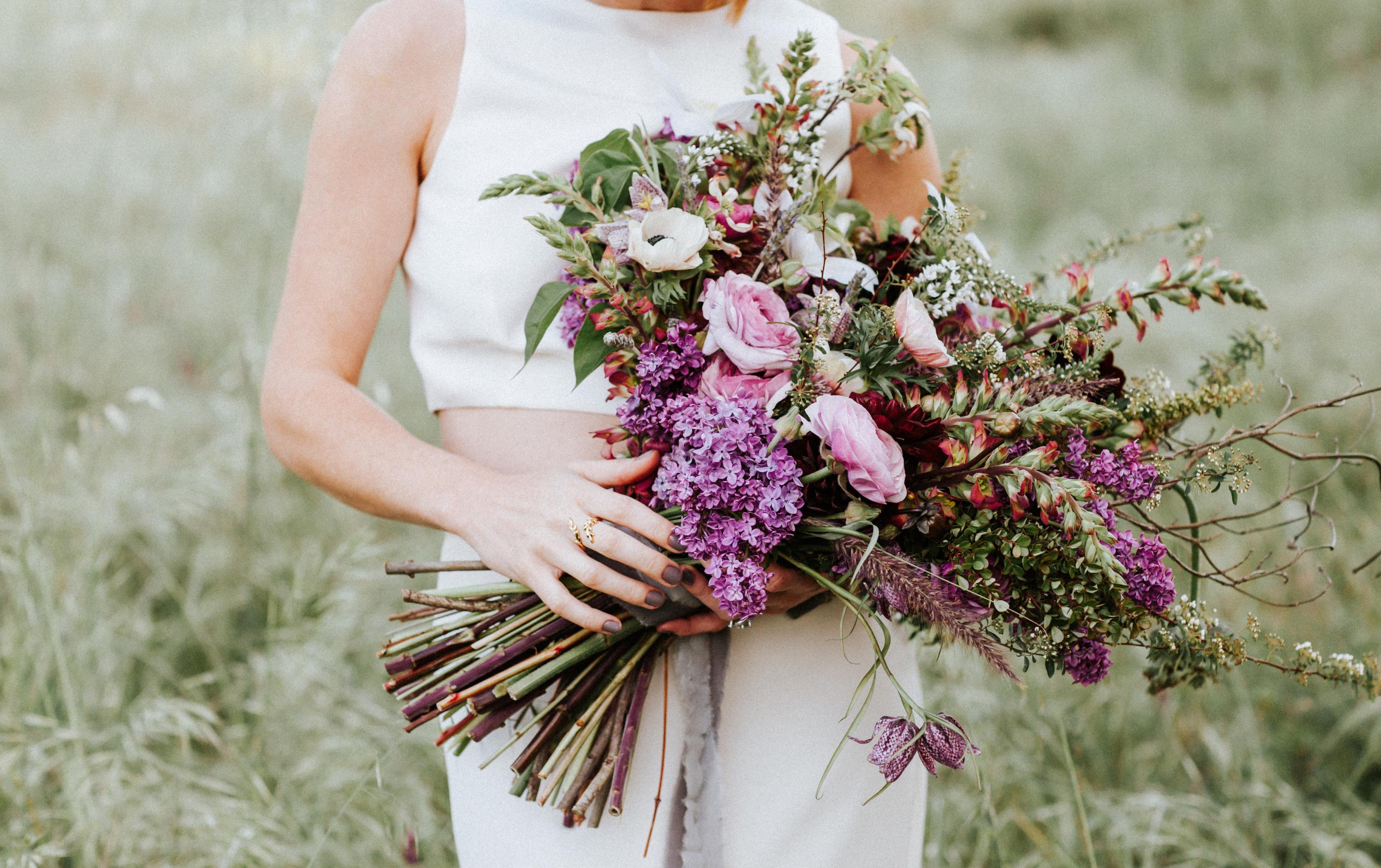 A Bride Holding a Purple Lilac Bouquet