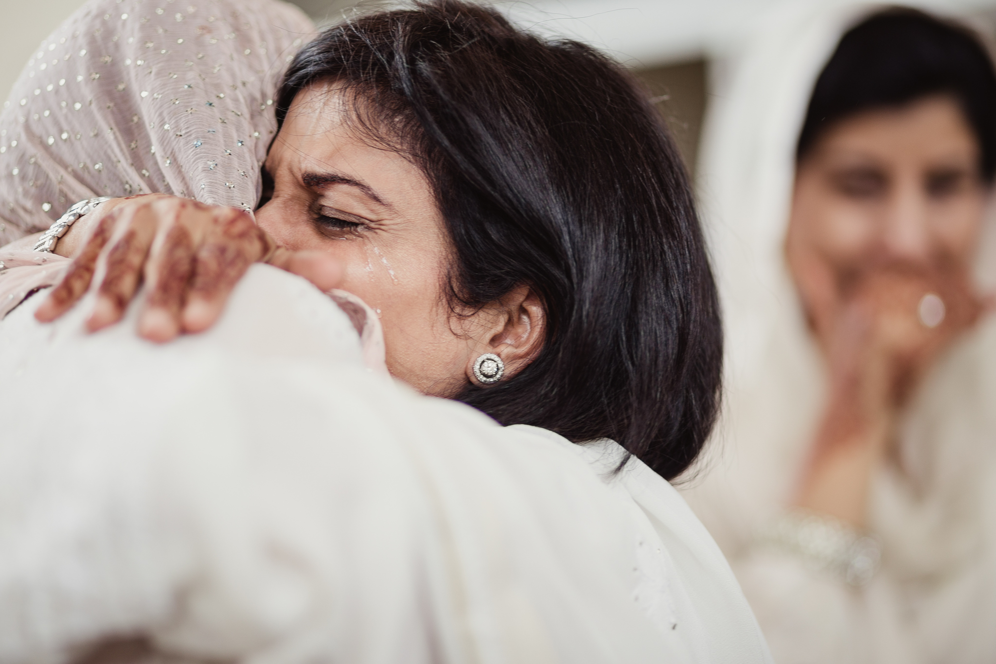 A Bride Crying and Hugging Her Mother