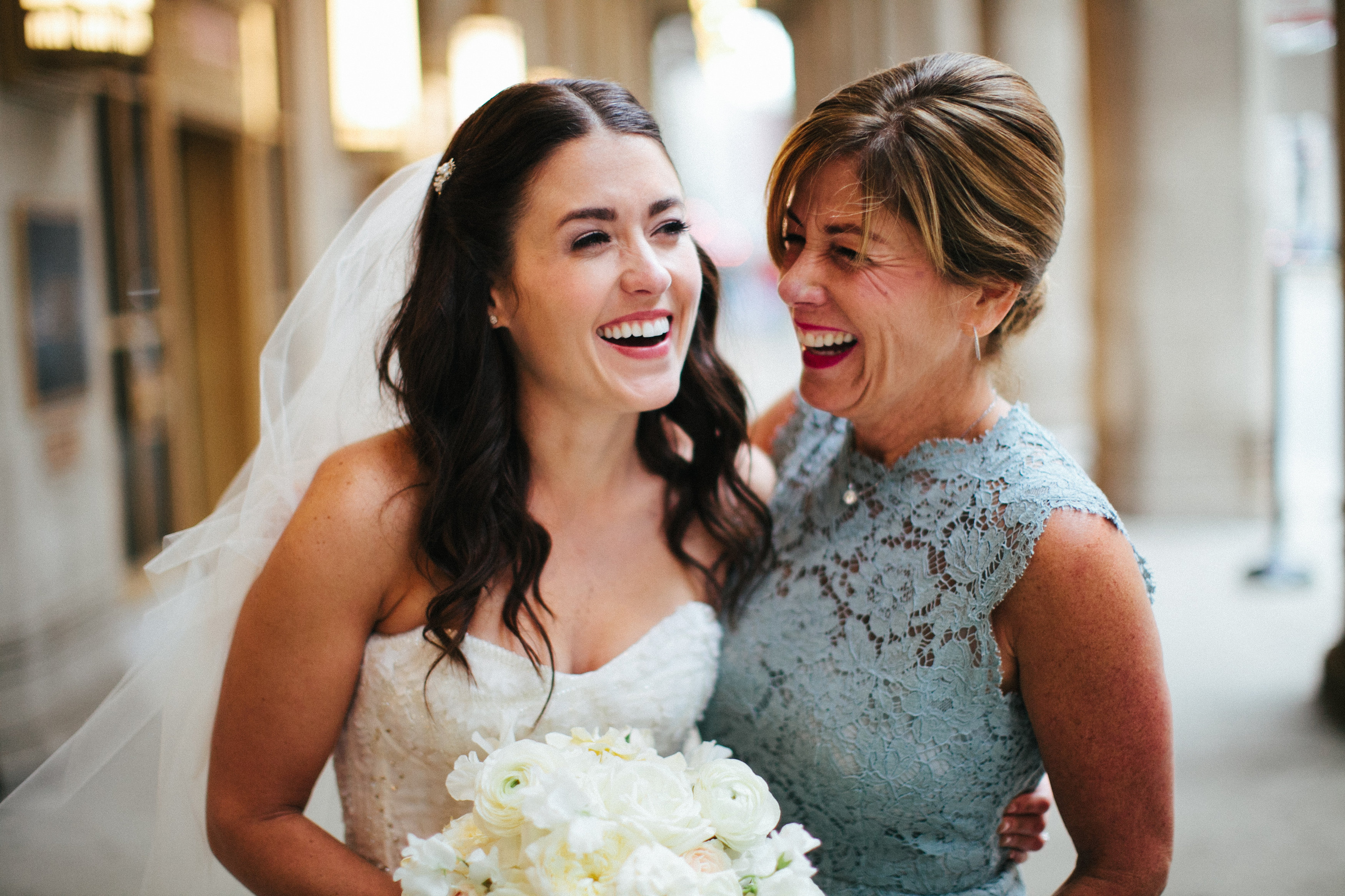 A Bride and Her Mother Laughing on Her Wedding Day