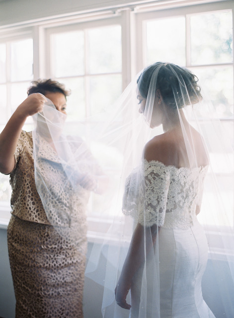 A Mother Holding Her Daughter's Wedding Veil
