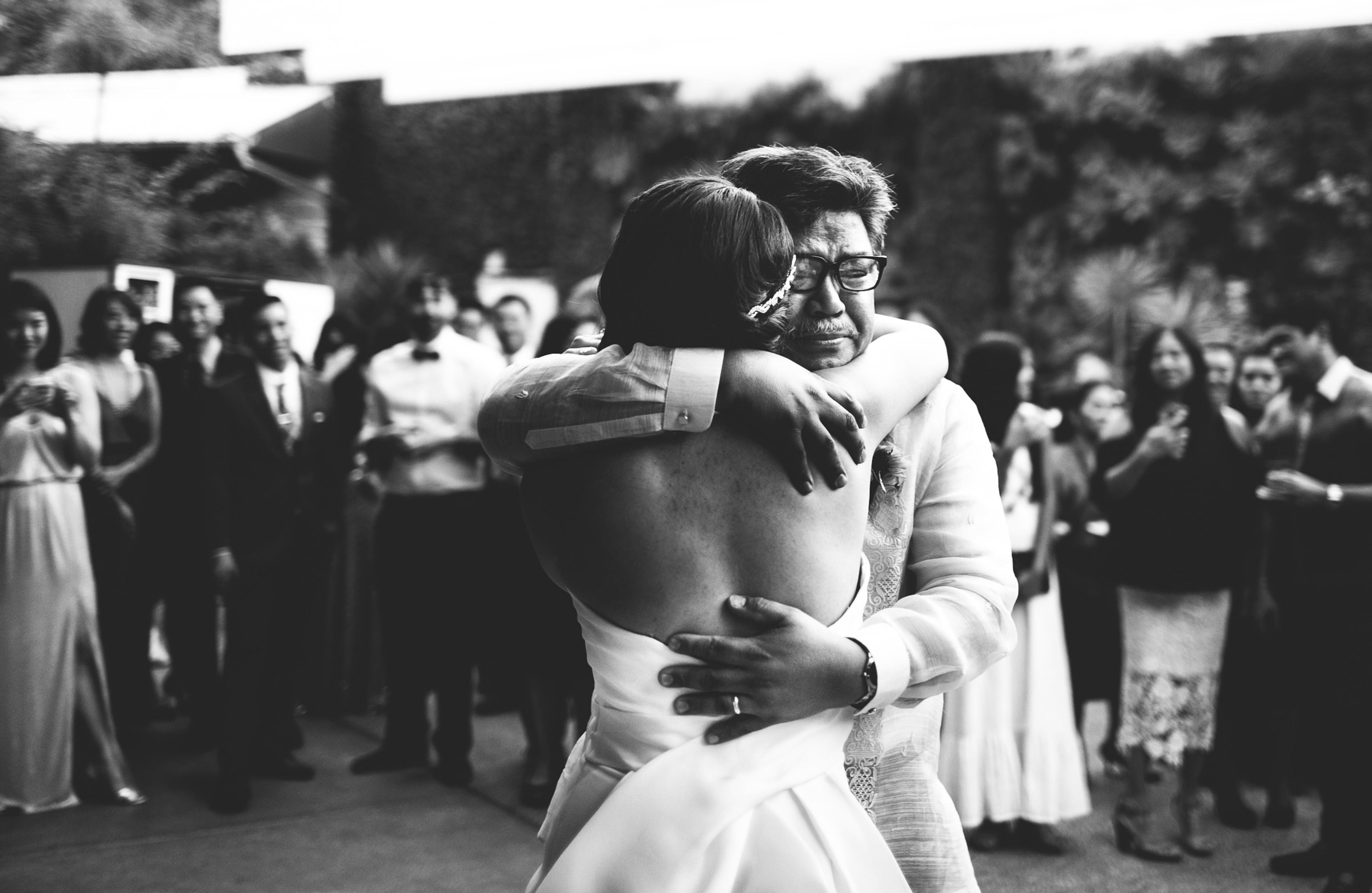 dad daughter wedding moment hug emotional