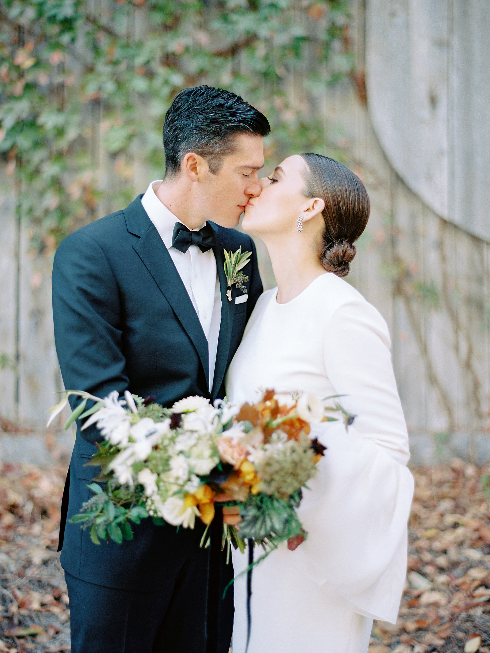 bride groom kissing portrait