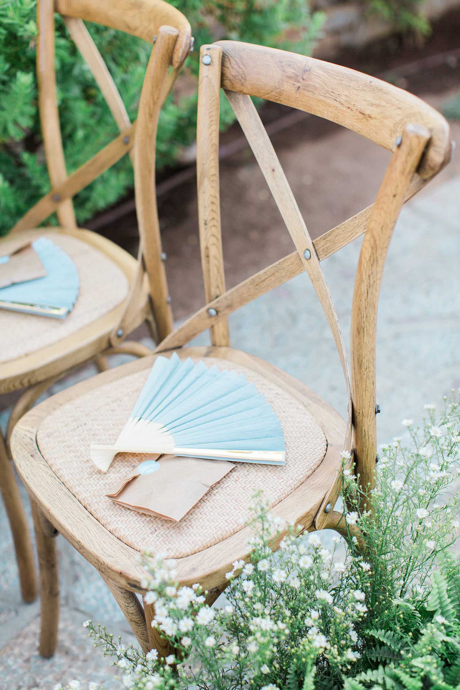 Elegant outdoor wedding ceremony with paper fans