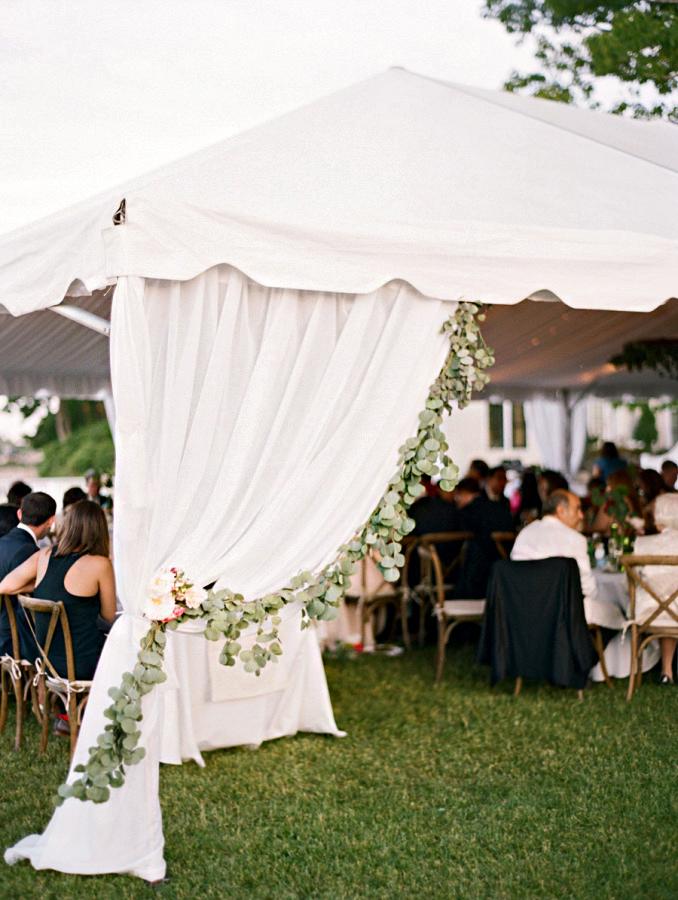 rainy wedding reception tent with greenery