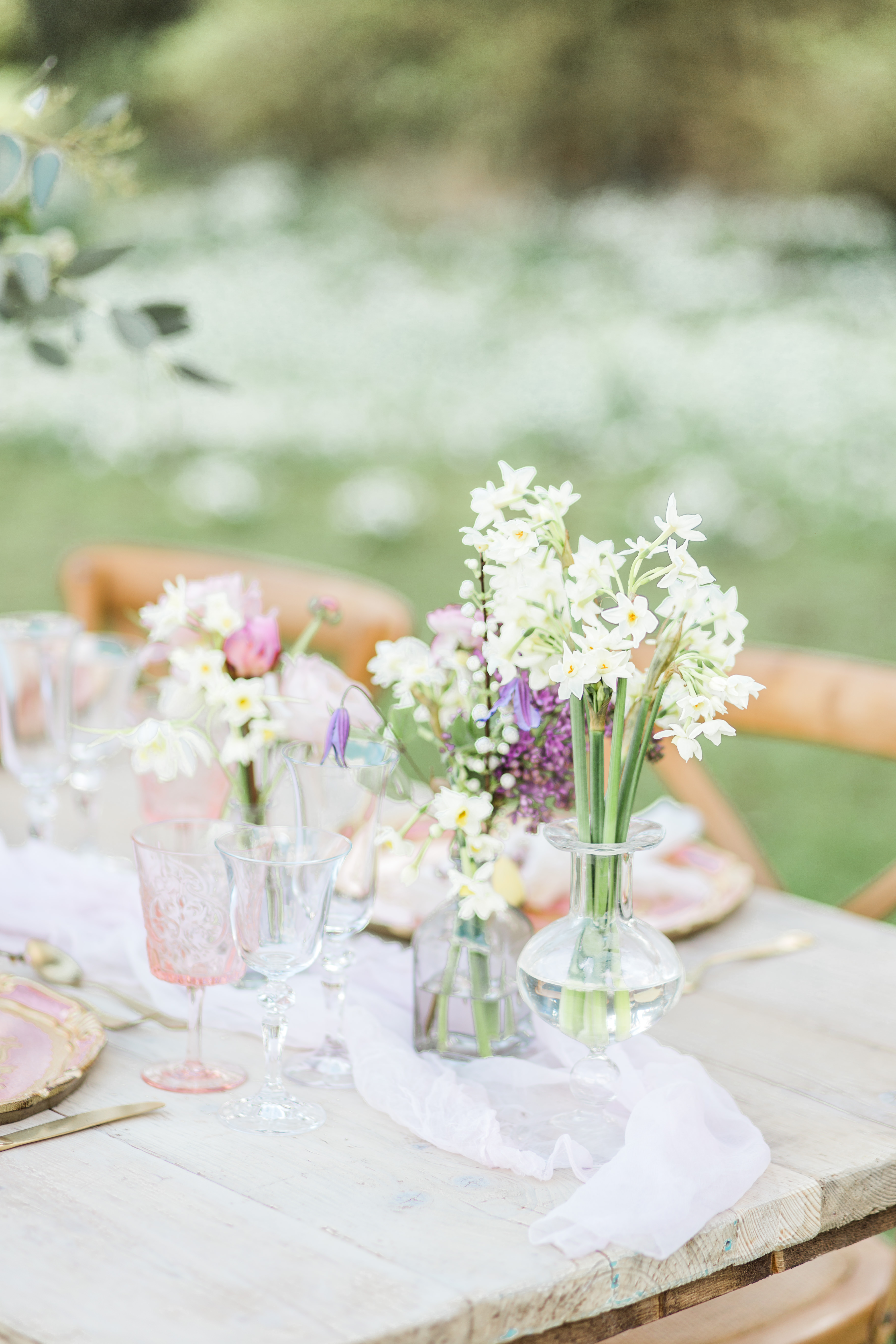 Clustered Centerpieces in Clear Vases with White and Purple Flowers