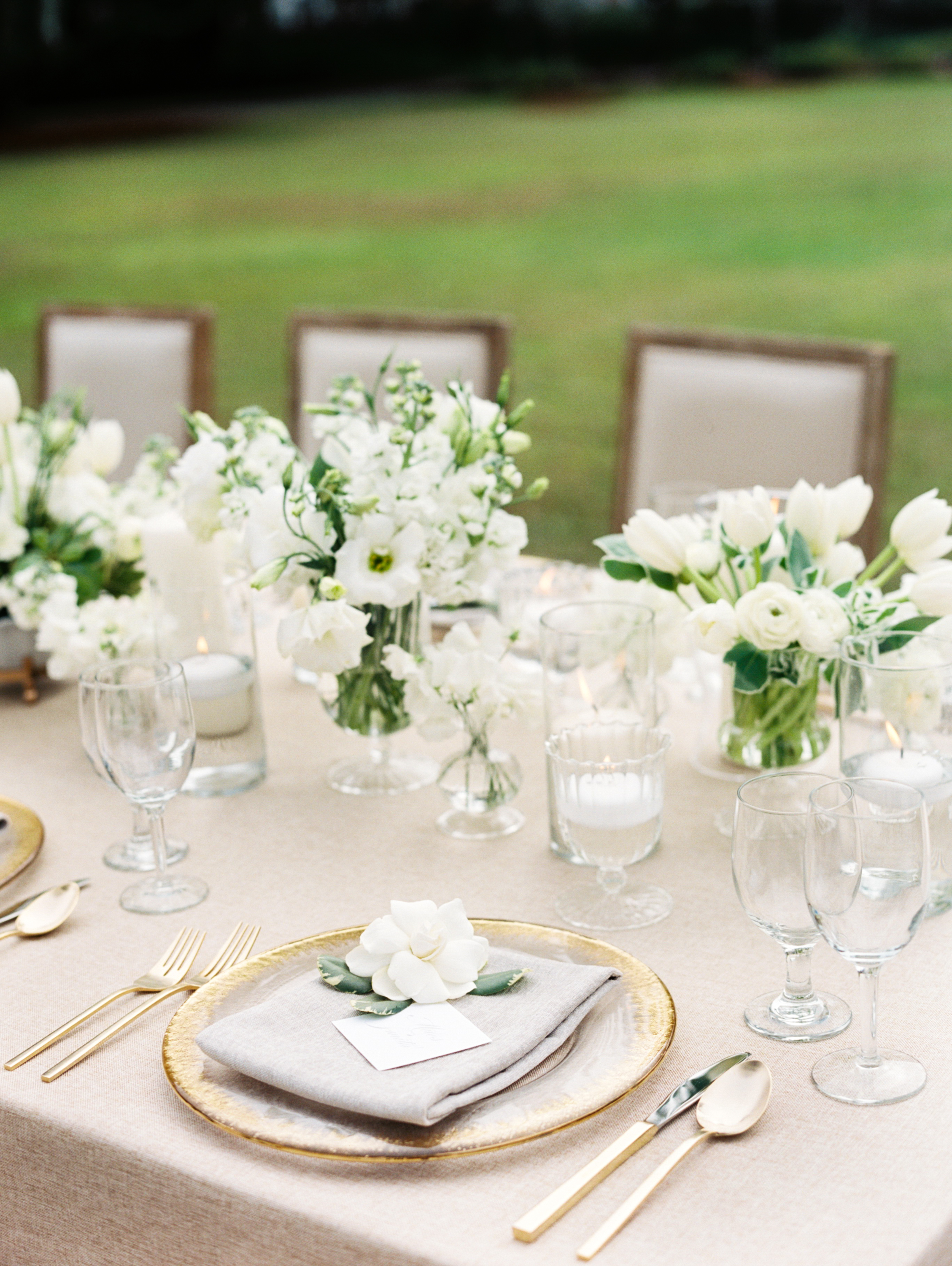 All-White Cluster centerpieces with Ranunculus
